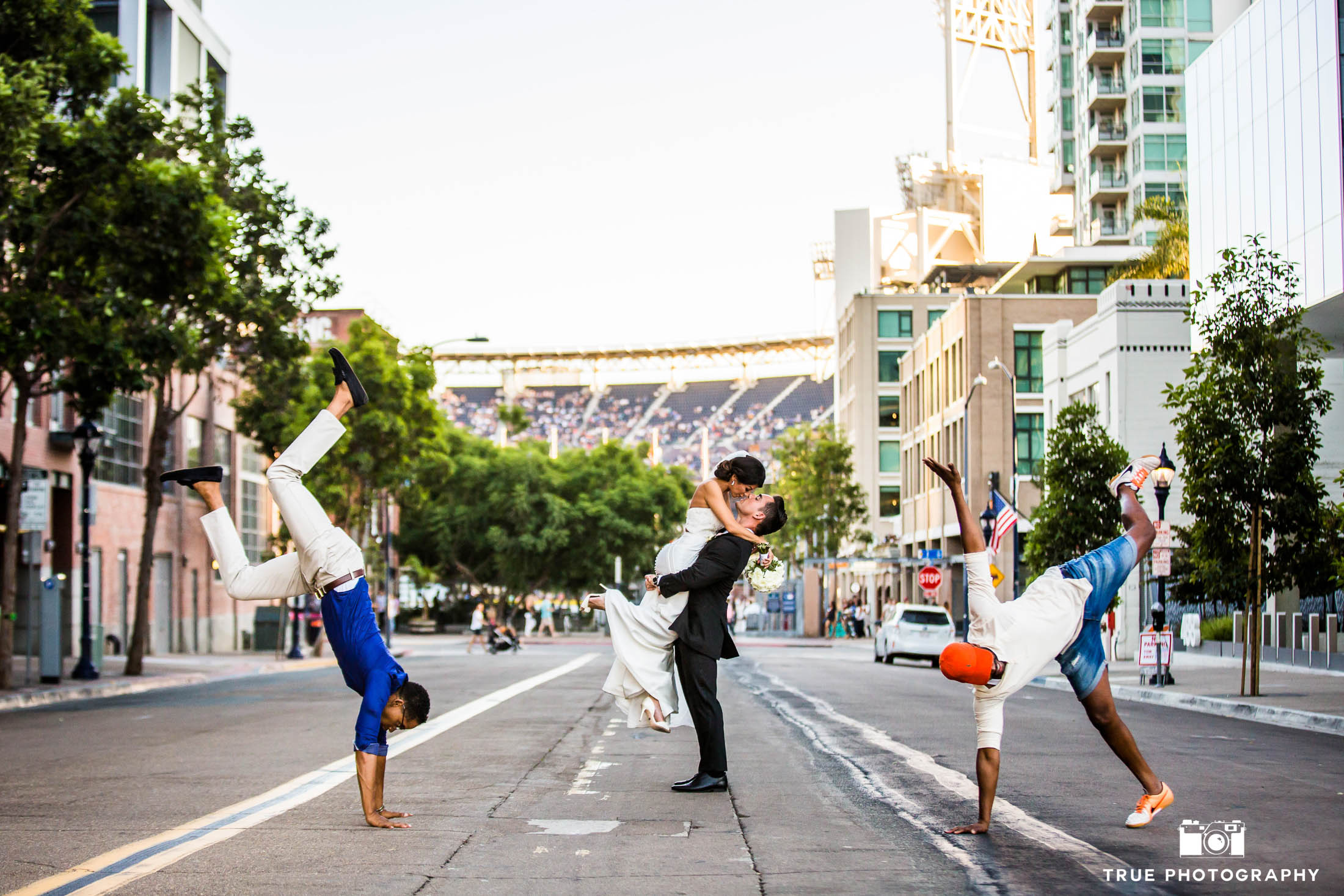 Breakdancers perform as bride and groom kiss in downtown san diego