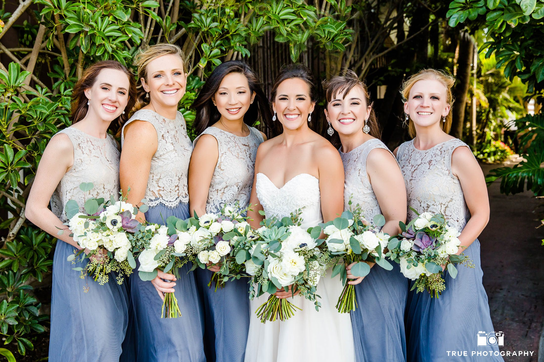 Bridesmaids in two-piece dresses with Bride