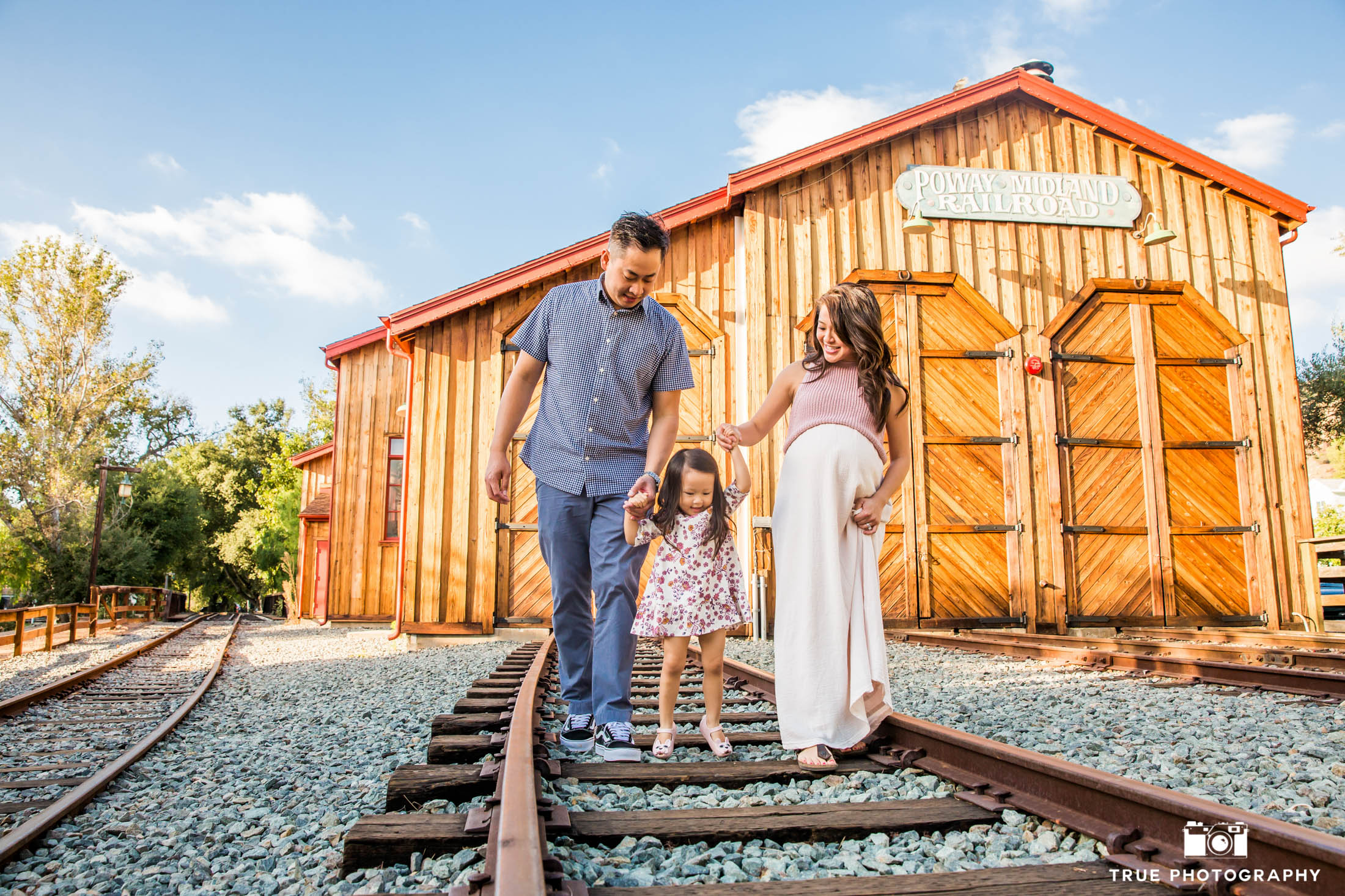 Family session strolling along the train tracks