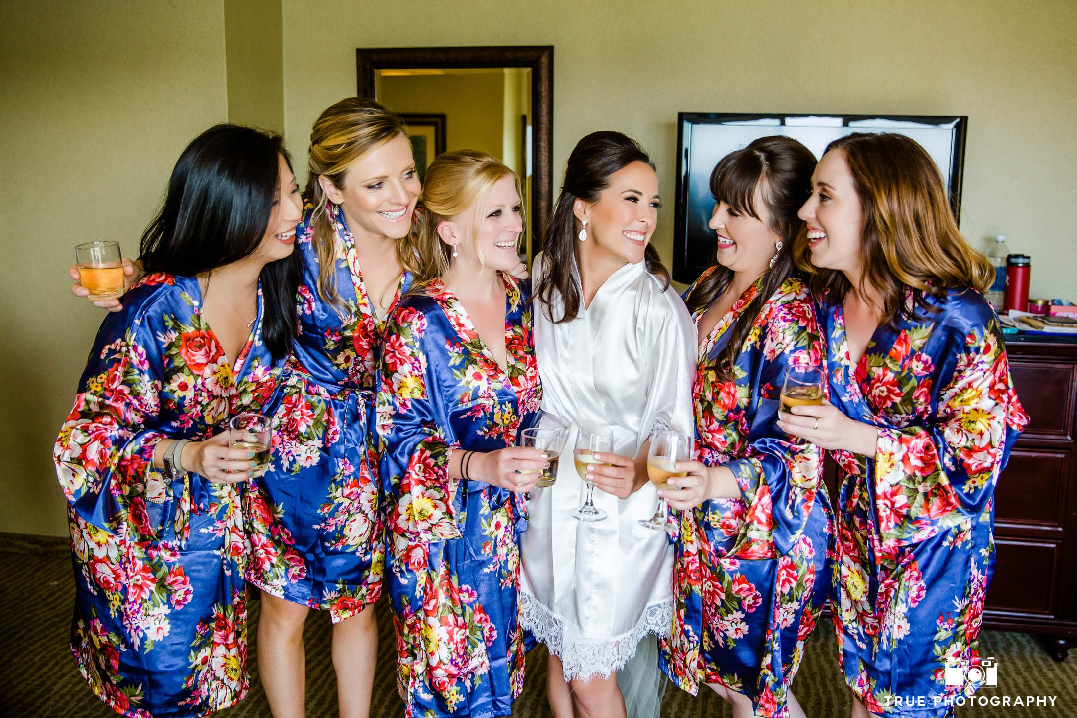 Bridesmaids in Robes Celebrate with Champagne Toast