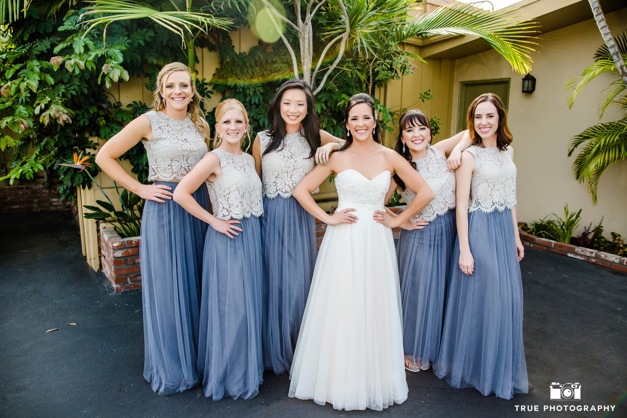 Bridesmaids laugh and smile