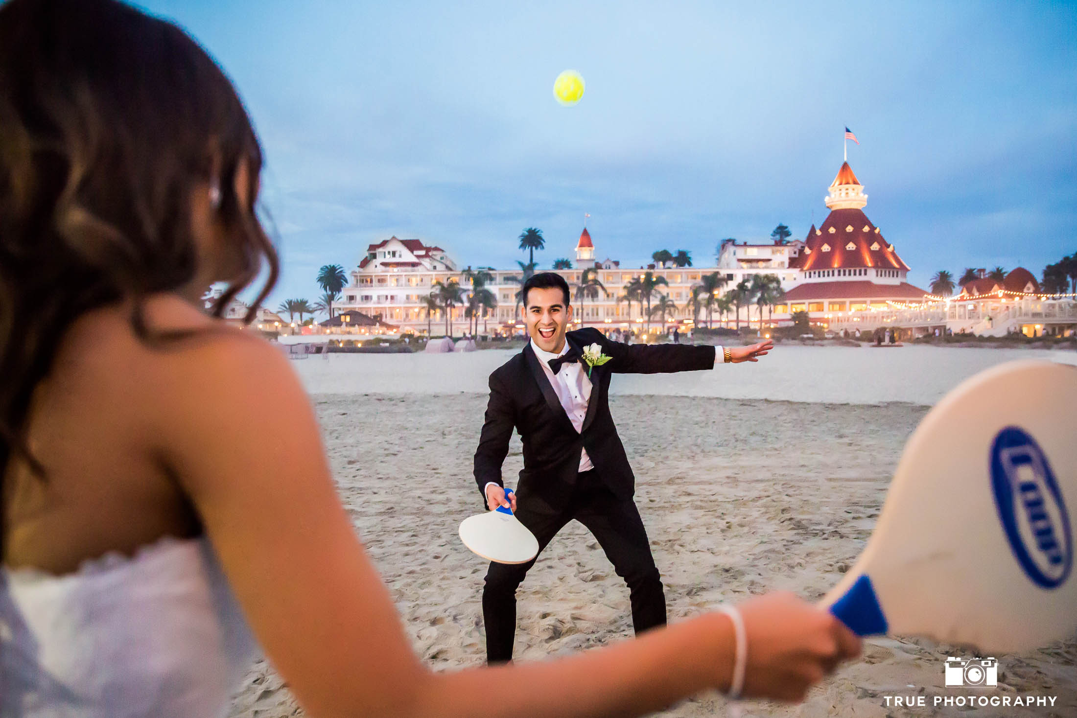 Groom's fun reaction to playing with Bride at Hotel Del Coronado