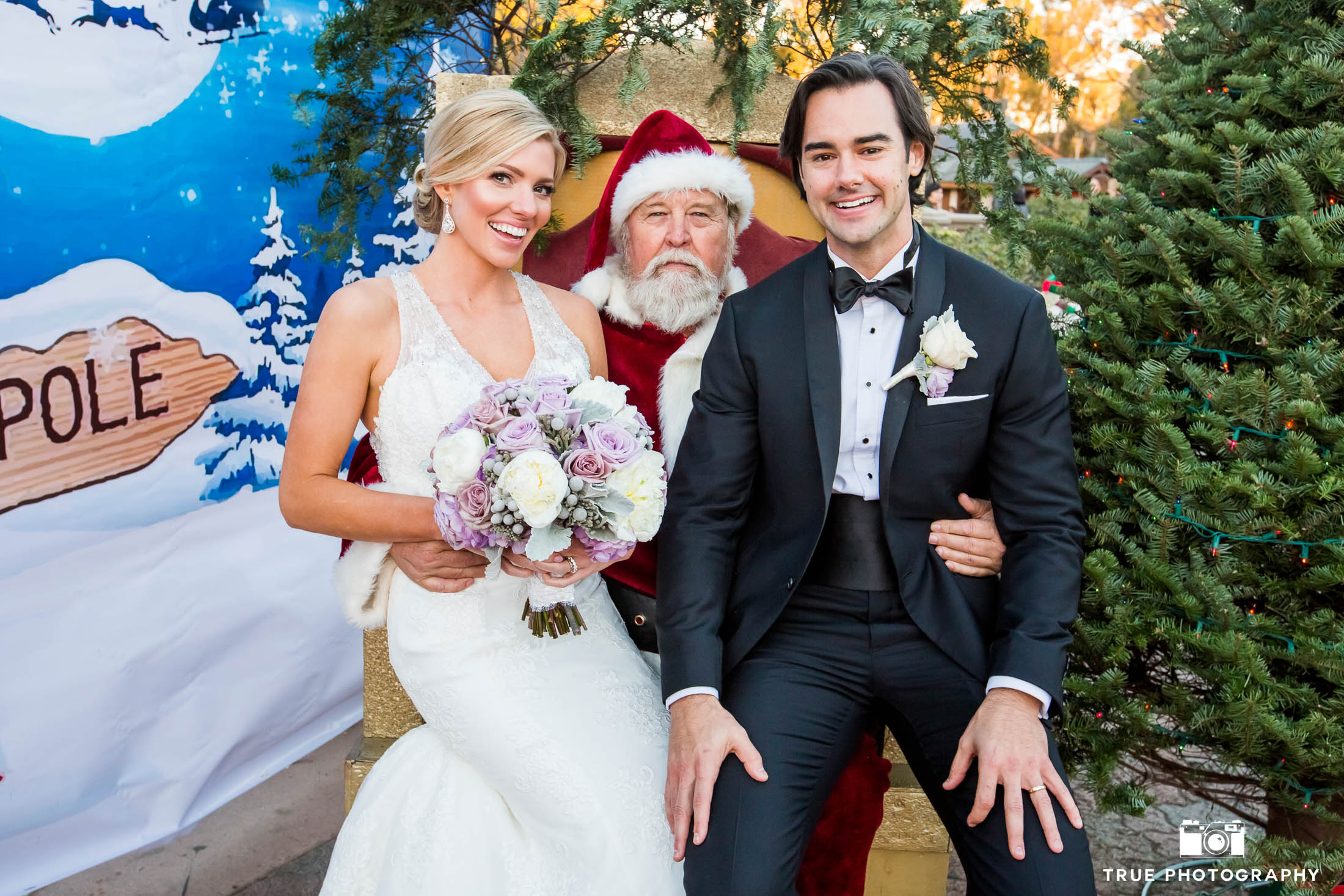 Bride and Groom sit on Santa's Lap for funny photo at Balboa Park