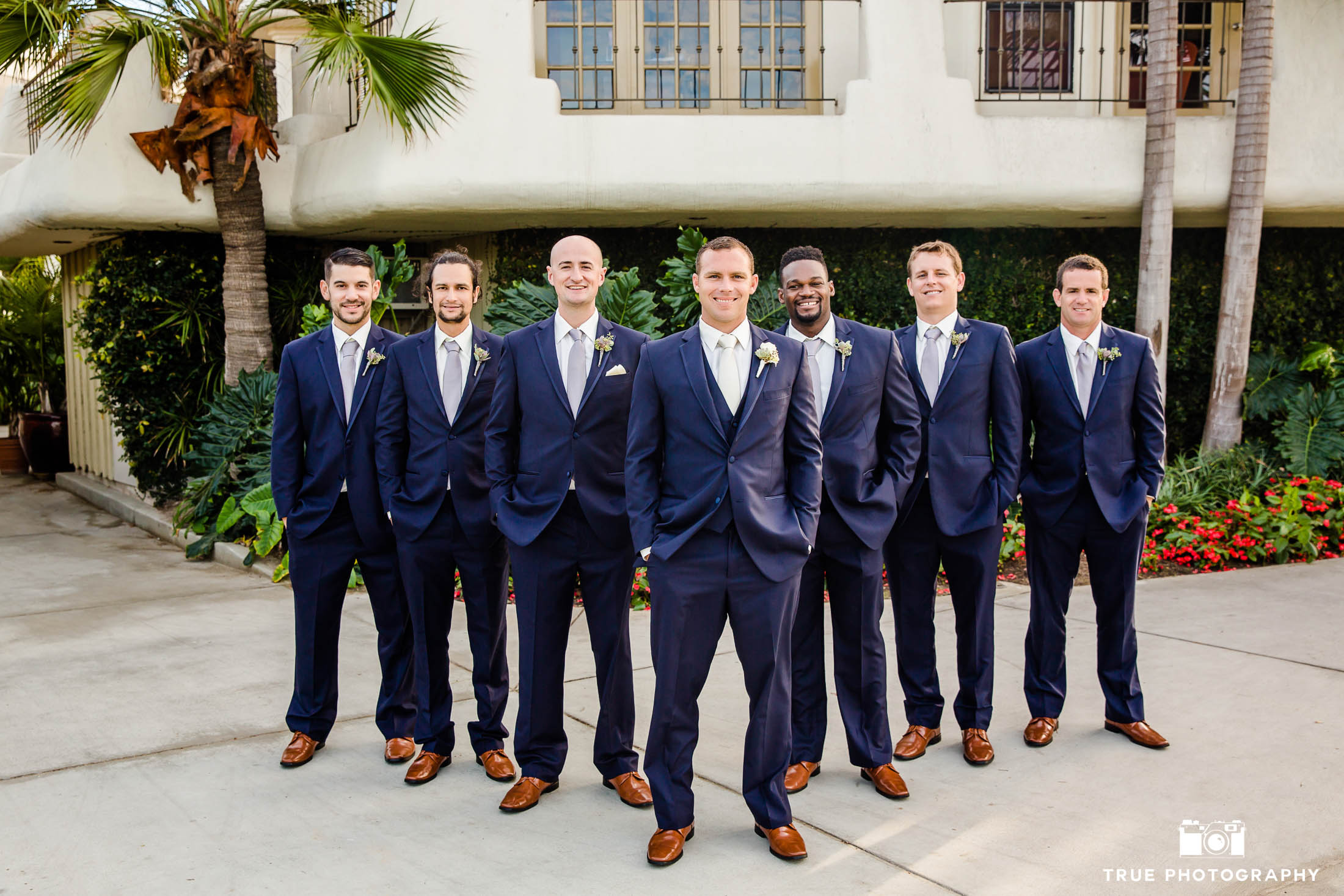 Groomsmen Standing with Matching blue suits and brown shoes
