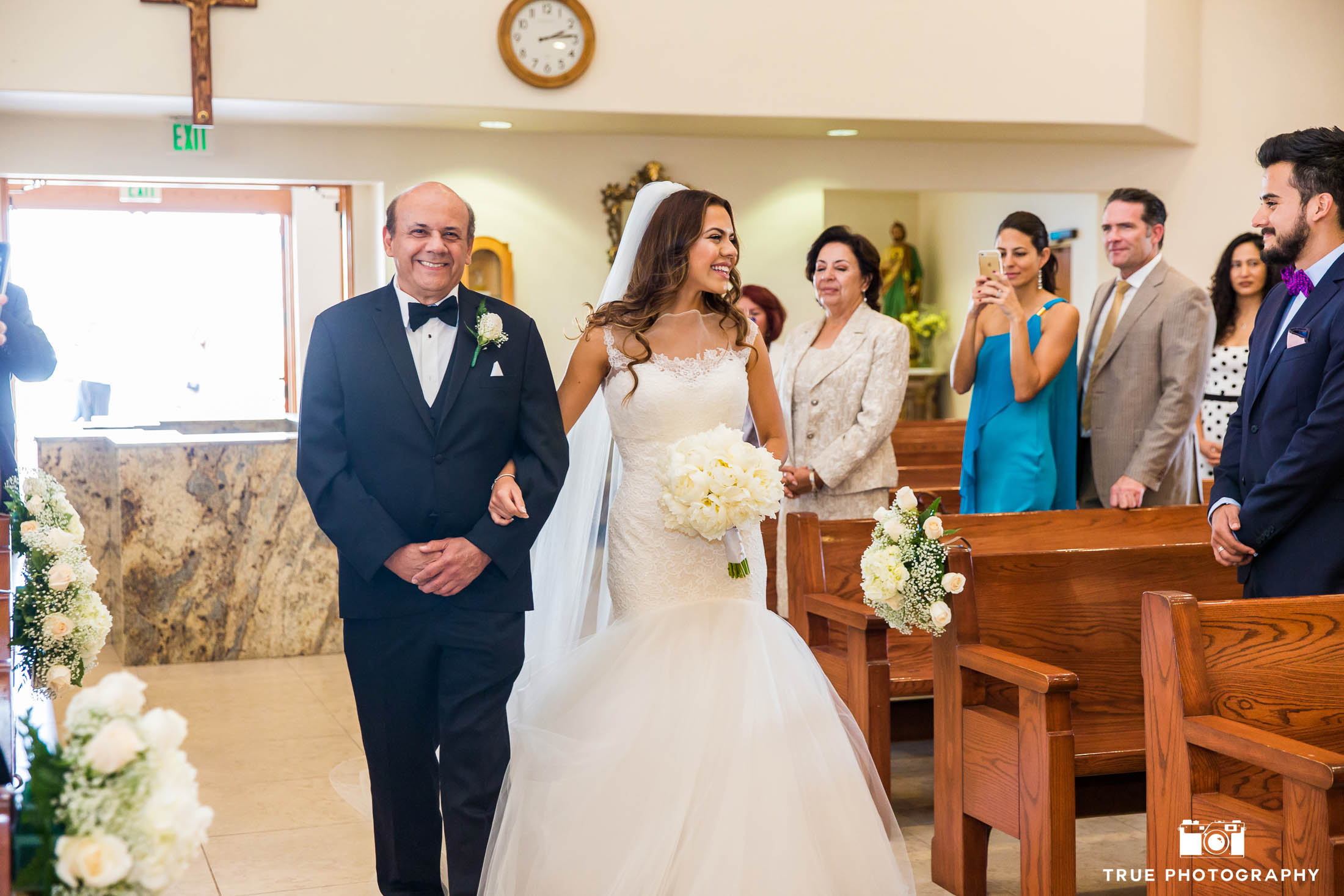 Father's candid reaction to walking bride down aisle during church ceremony