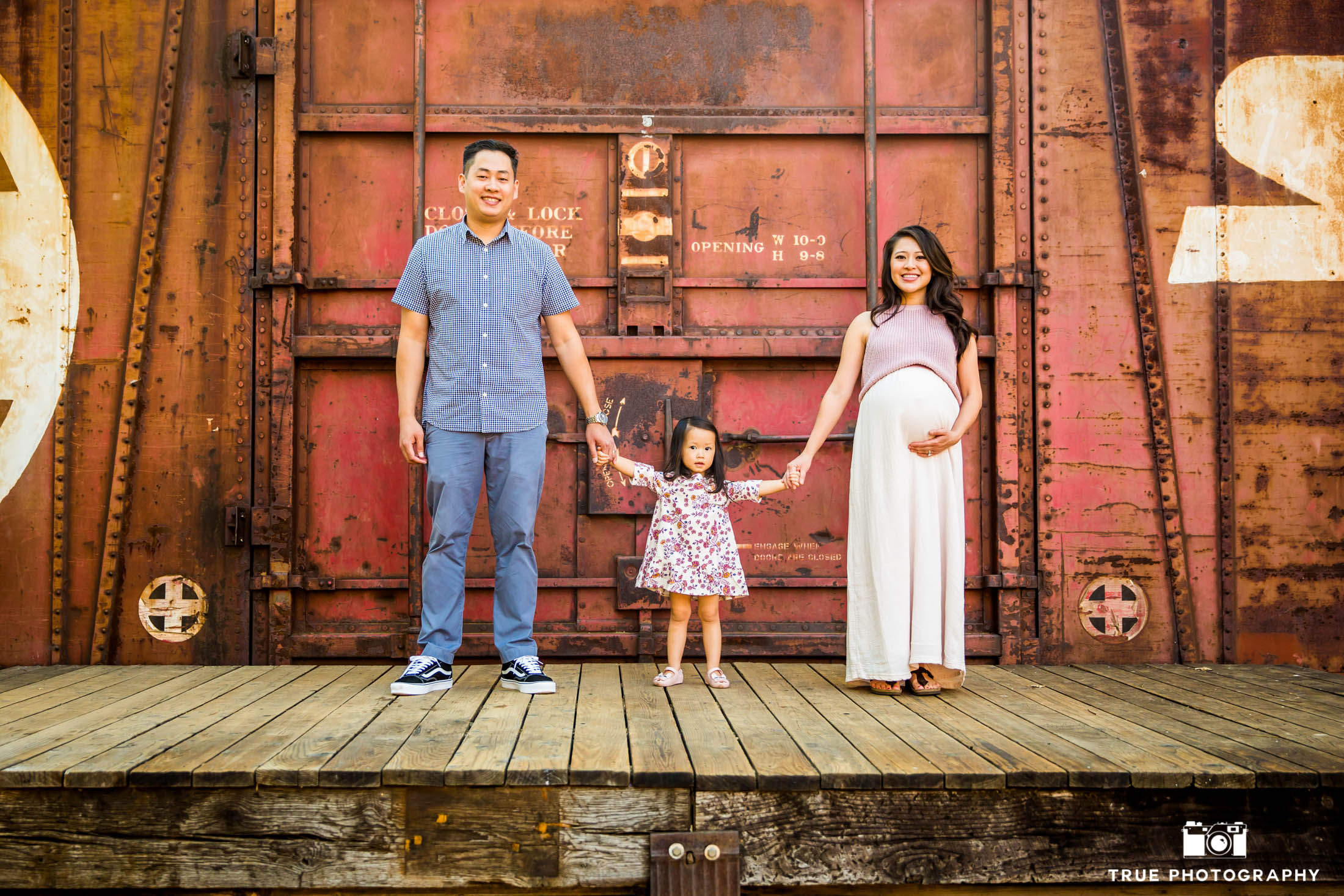 This family of three will soon be a family of four.