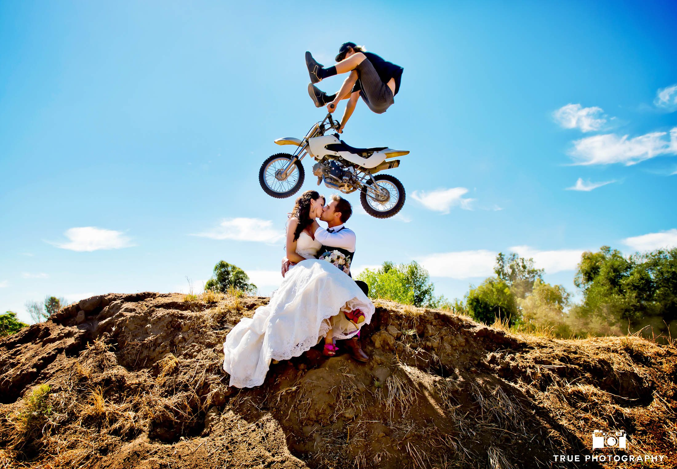 Wedding Couple Kiss as Dirtbiker performs trick