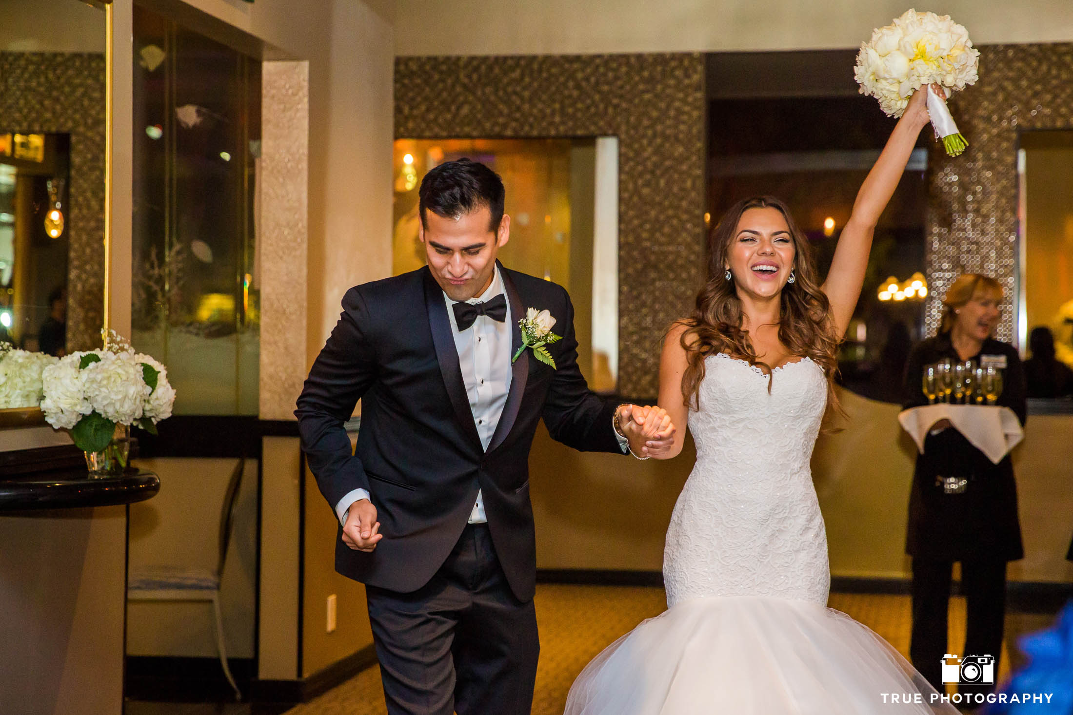 Bride and Groom cheer and dance during Grand Entrance