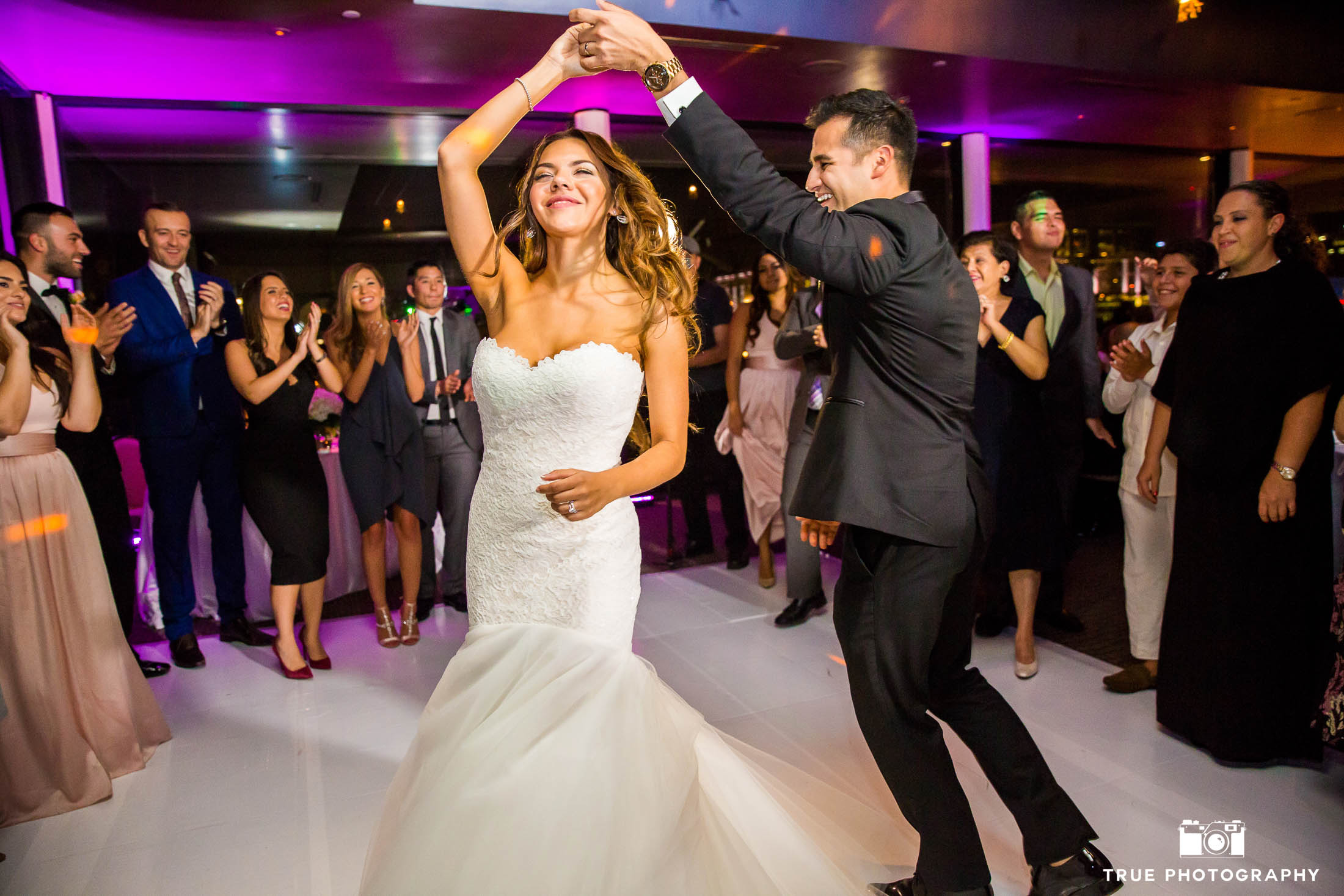 Guests cheer on as Bride and Groom celebrate their First Dance