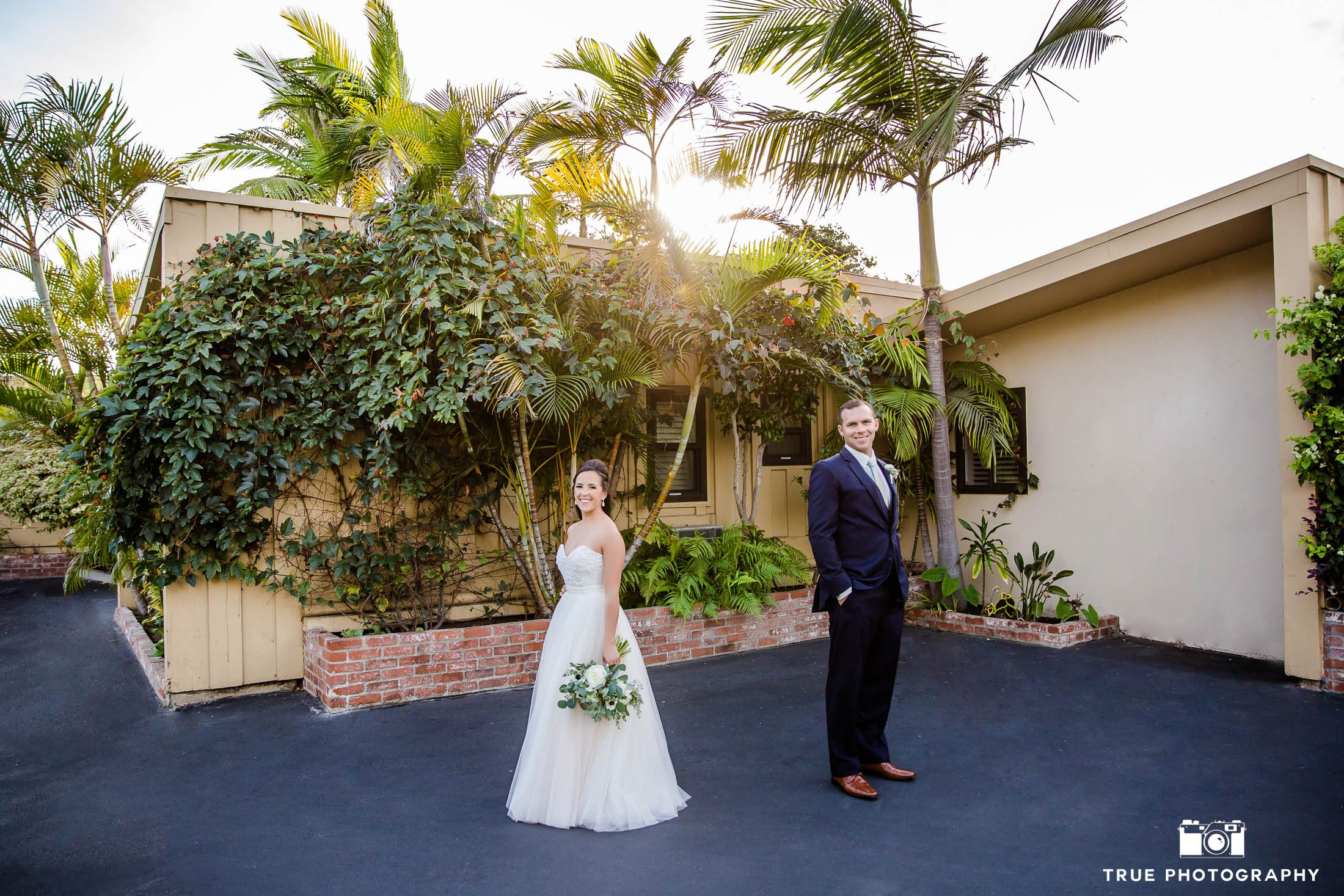 Bride and Groom face opposite directions and look into camera