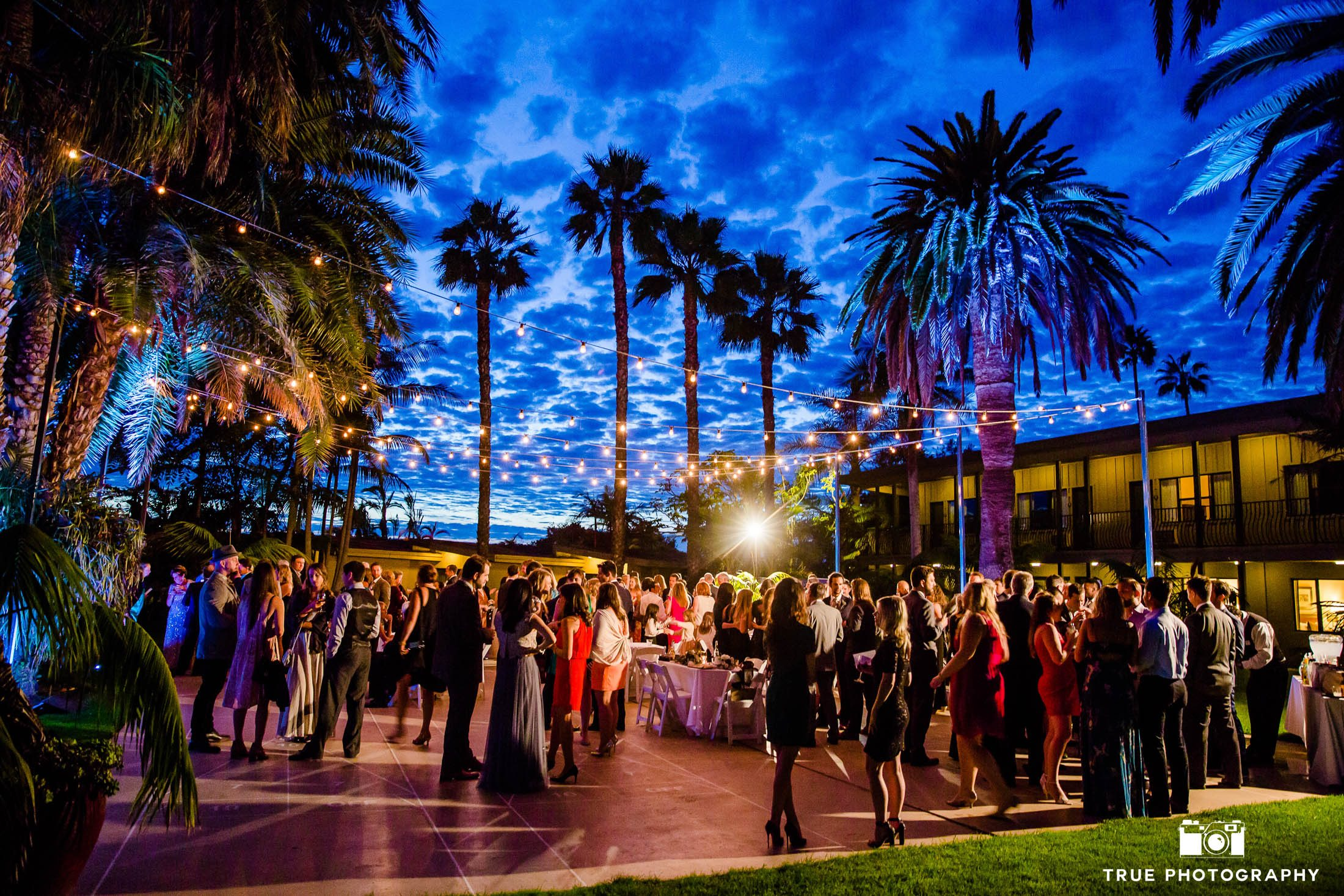 Creative and colorful reception lighting at sunset