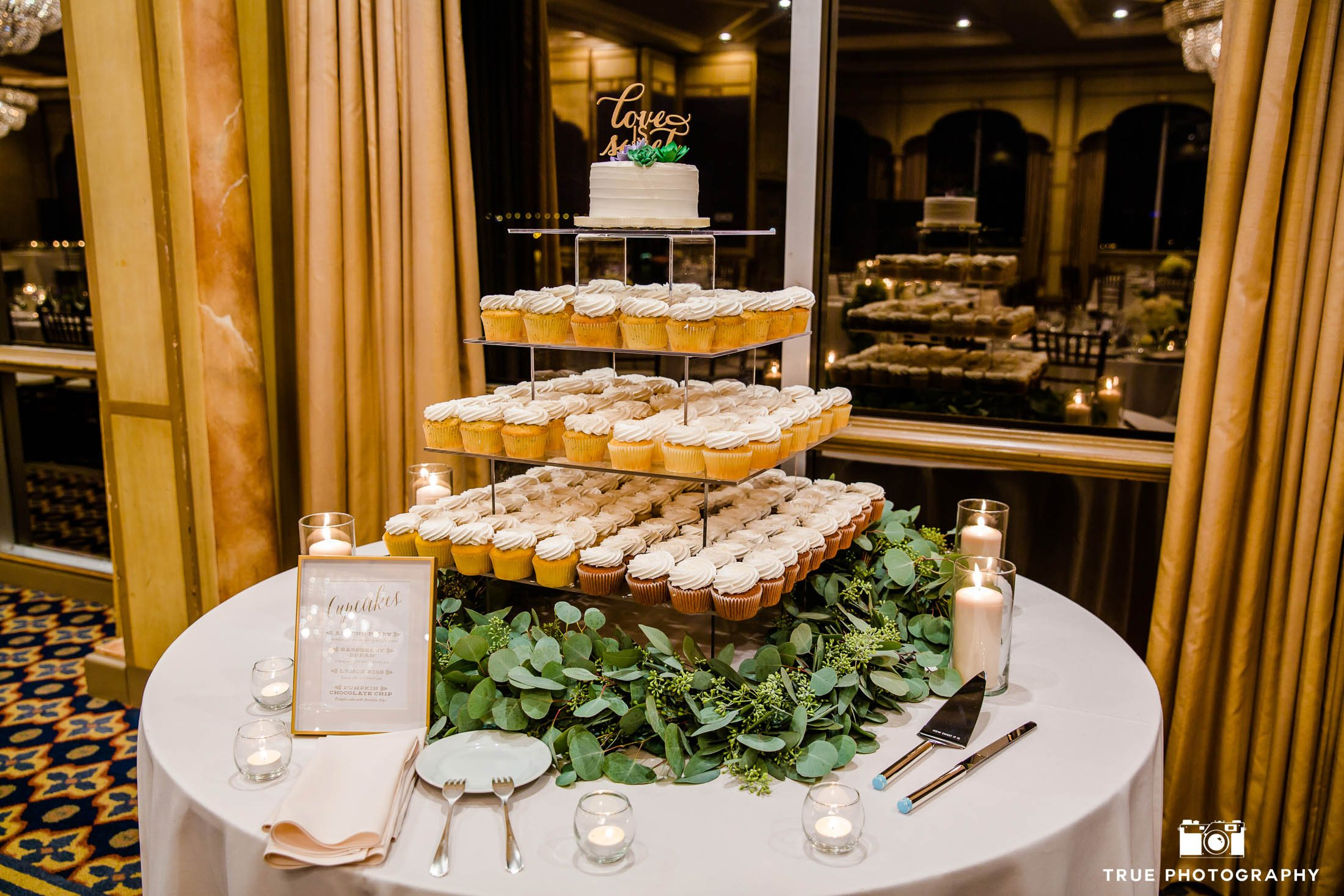 4-tier wedding cake and cupcakes by Flour Power