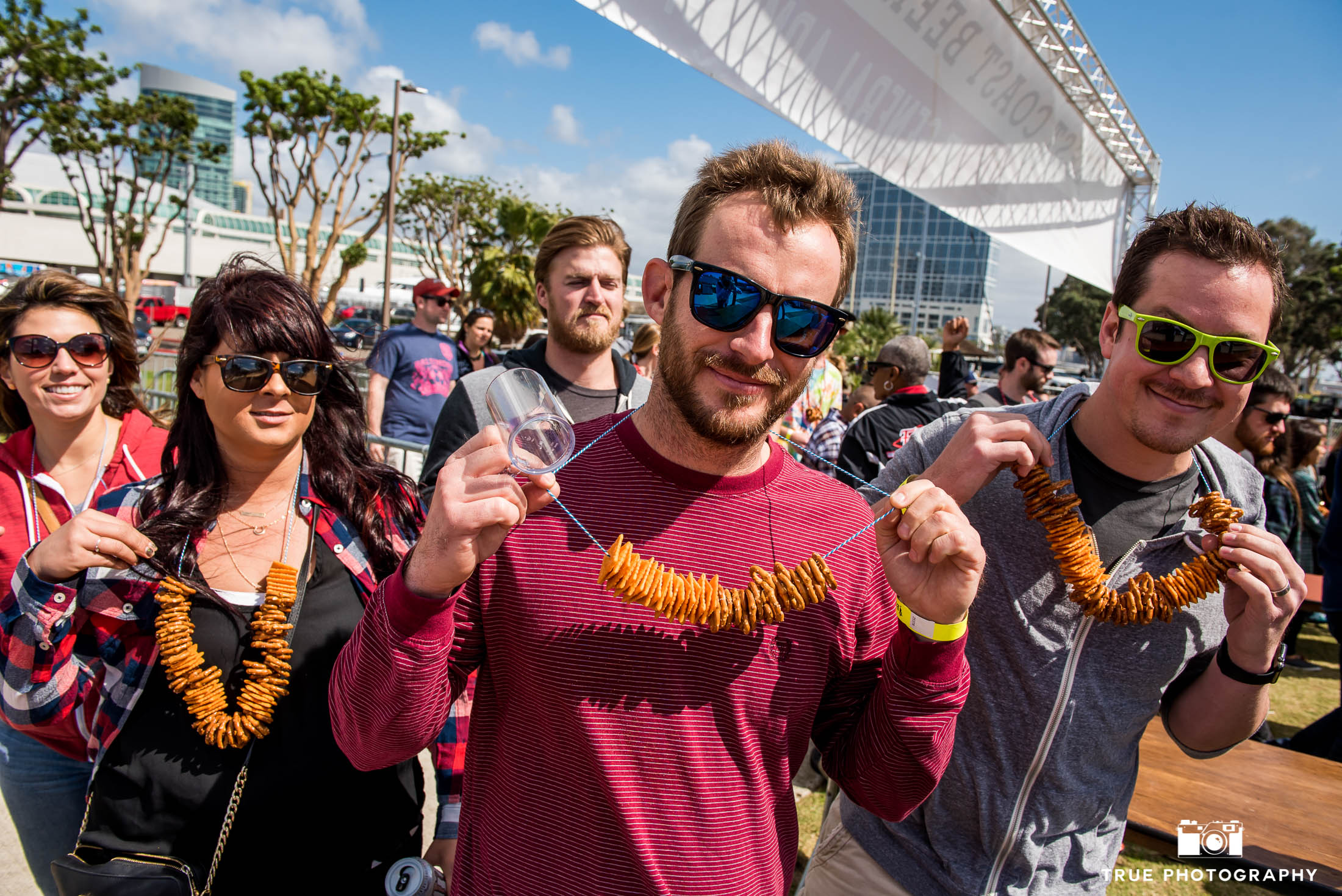 Eventgoers show off their Pretzel Necklaces at Beer Festival in Downtown San Diego