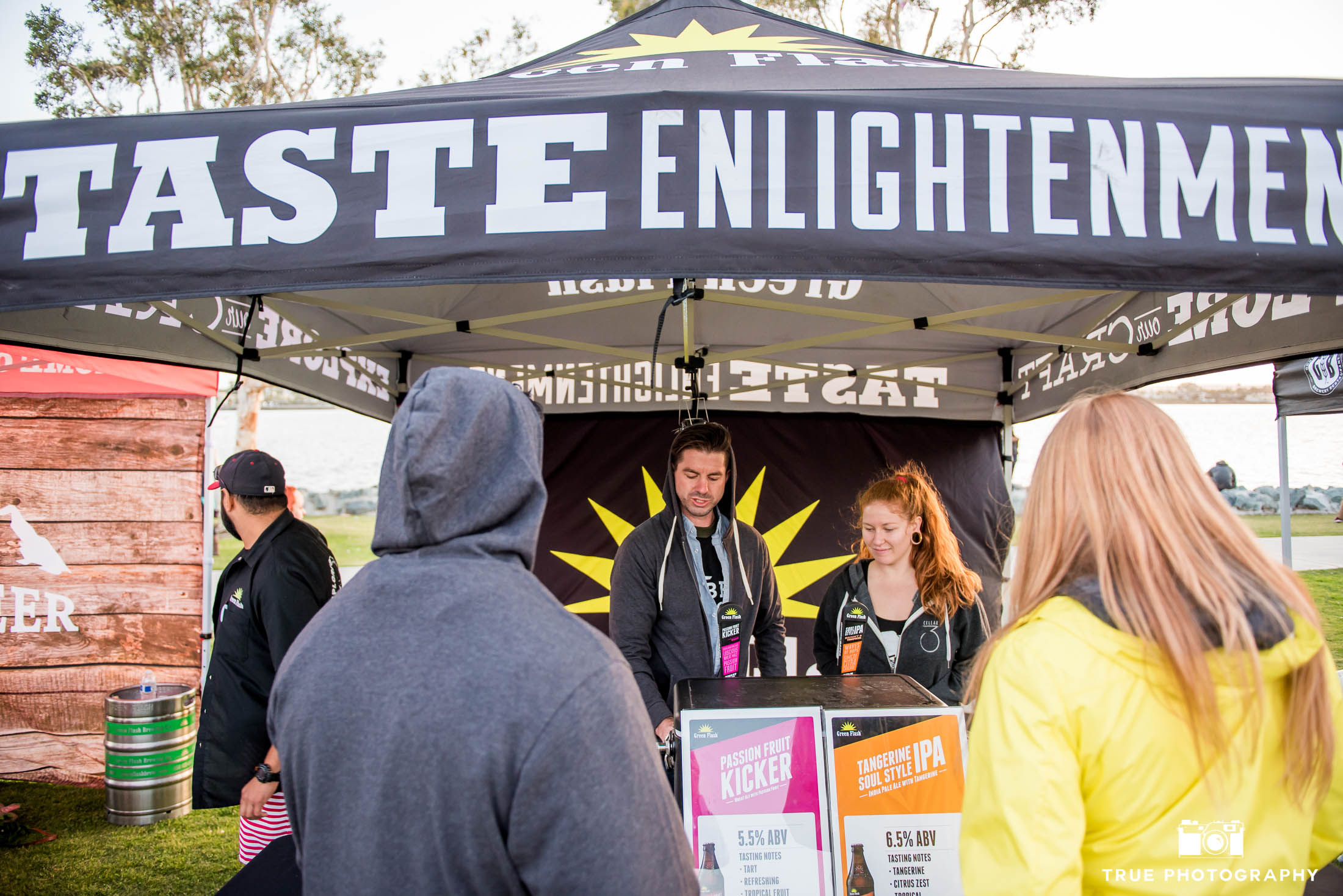 Greenflash Brewing Company hands out beer tasters to eventgoers at craft beer festival in Downtown San Diego