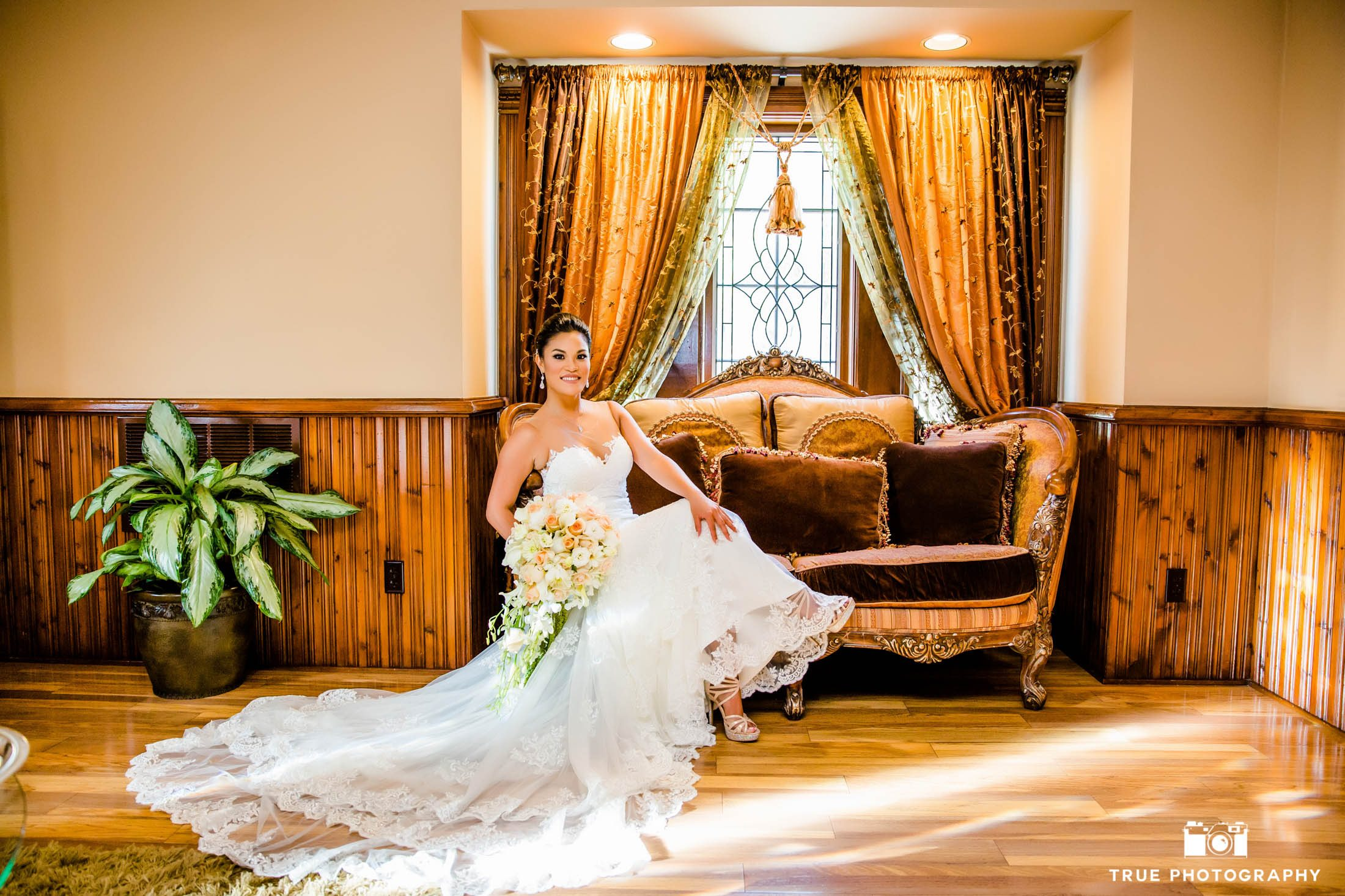 Bride sits casually in her dress