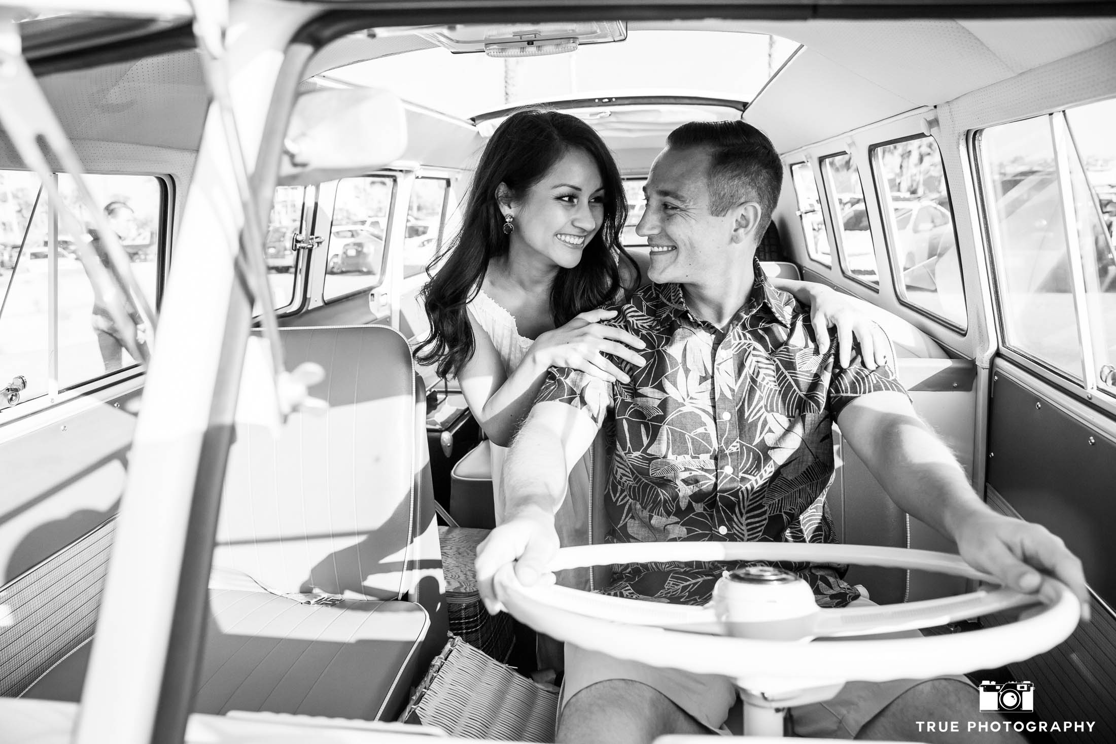 Groom-to-be drives Volkswagen bus as Bride-to-be sits behind him