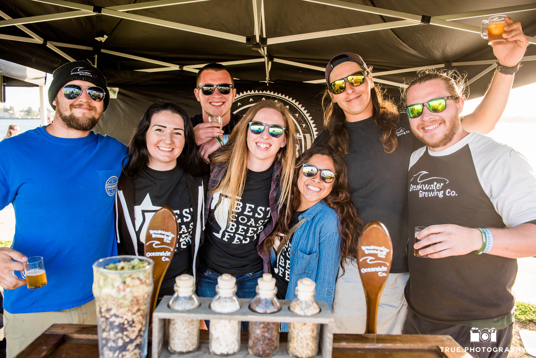 Young eventgoers have fun drinking beer at Best Coast Beer Fest in Embarcadero Park