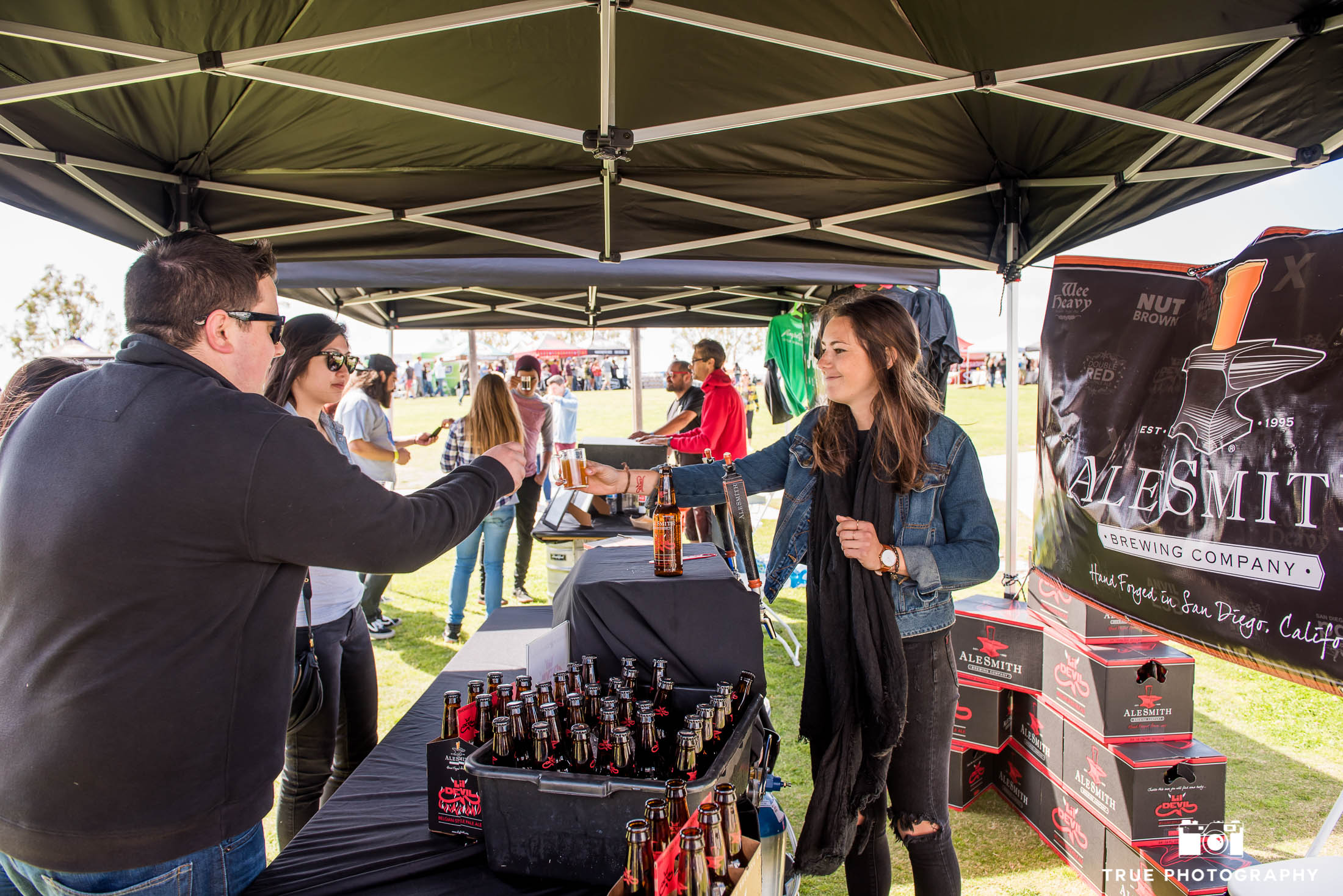 Alesmith Brewing Company hands out beer to eventgoers at Best Coast Beer Fest