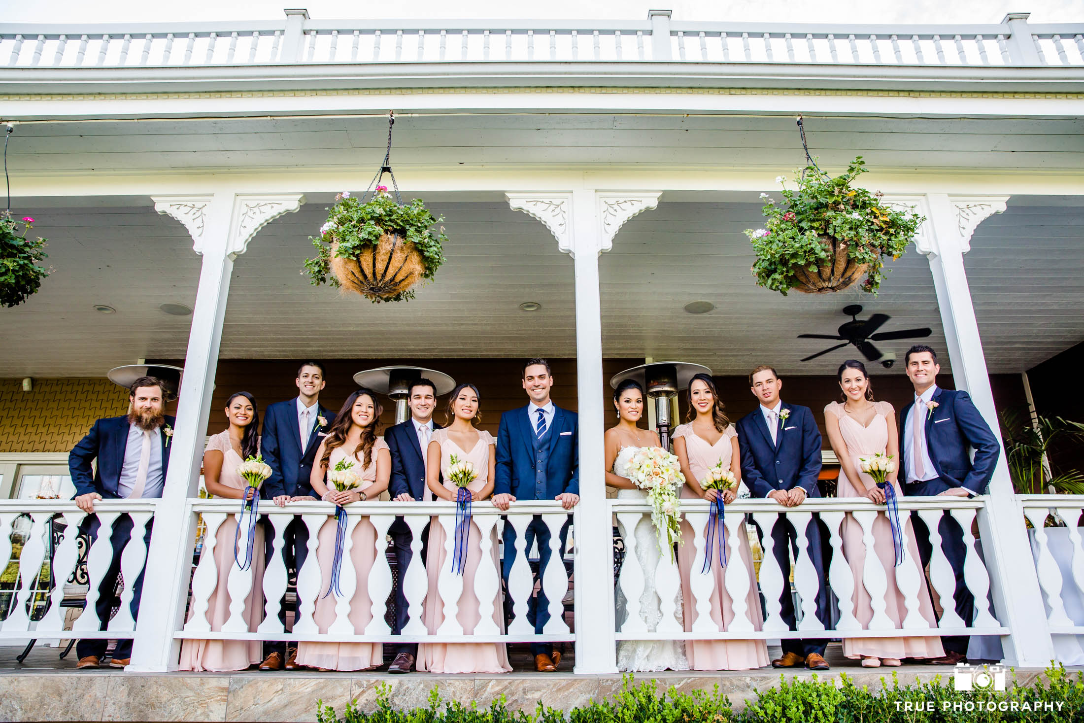 The mansion porch is a perfect place to take a bridal party photo.
