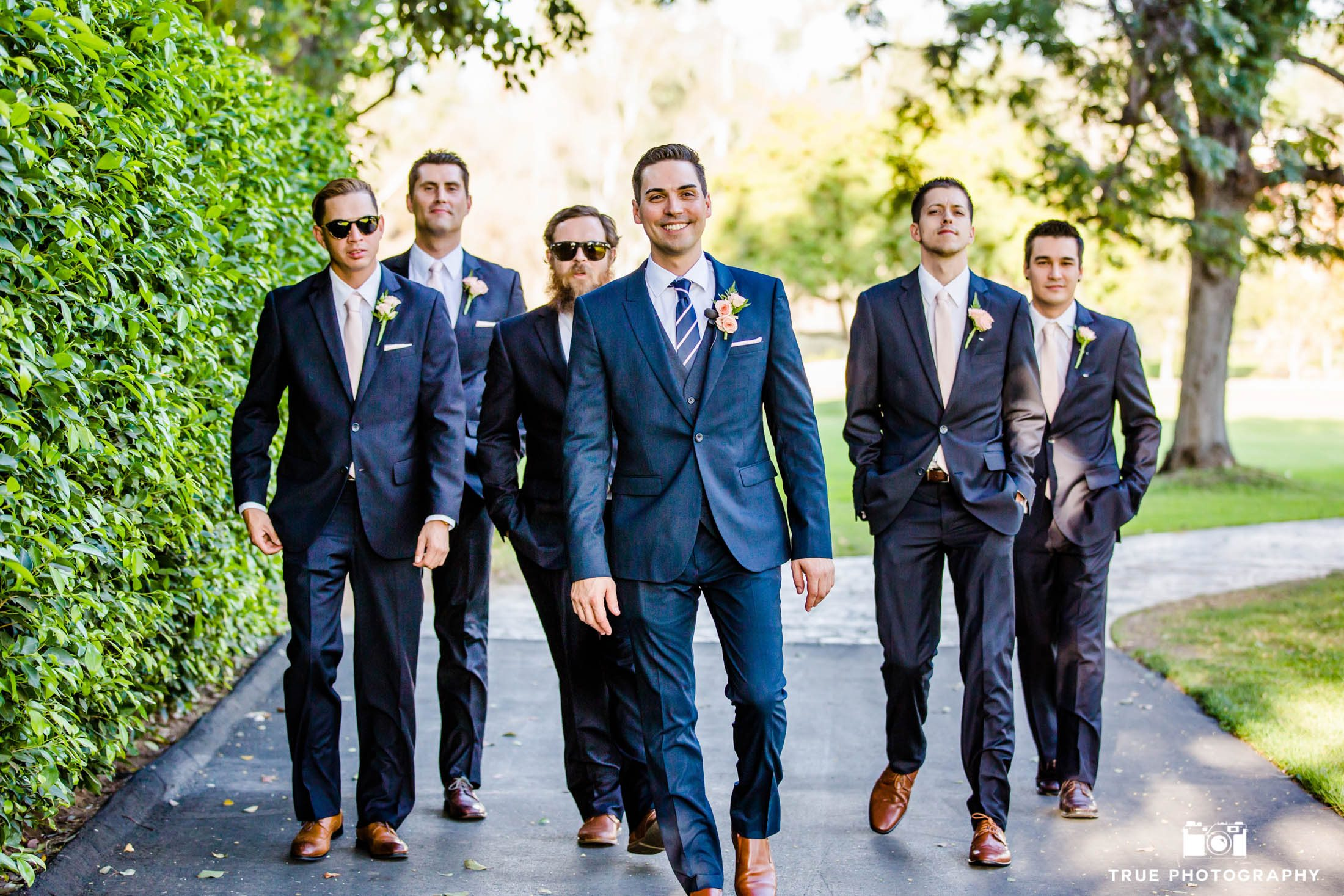 The groom and his groomsmen taking a walk