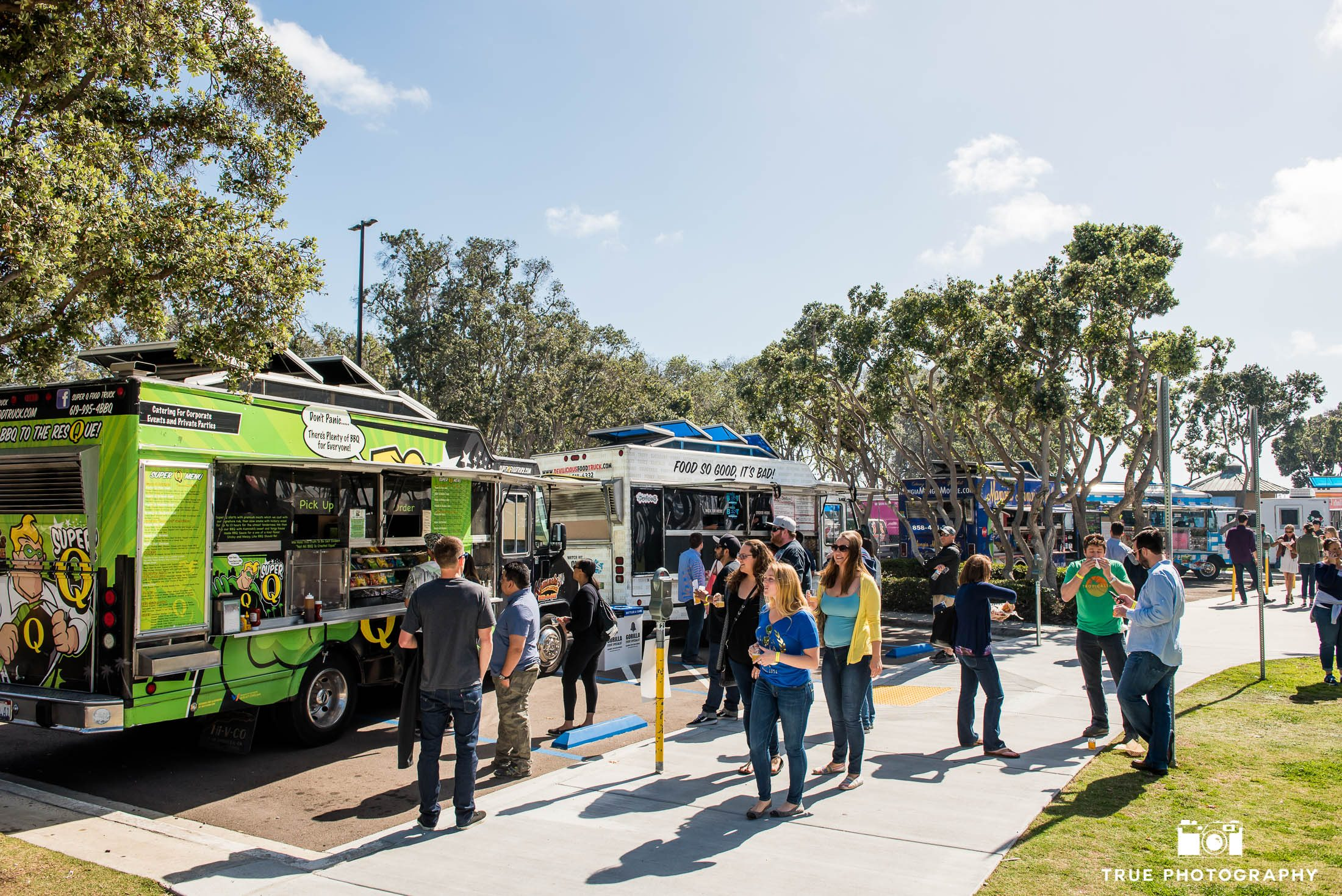 Eventgoers wait in lines for local food trucks at Best Coast Beer Fest