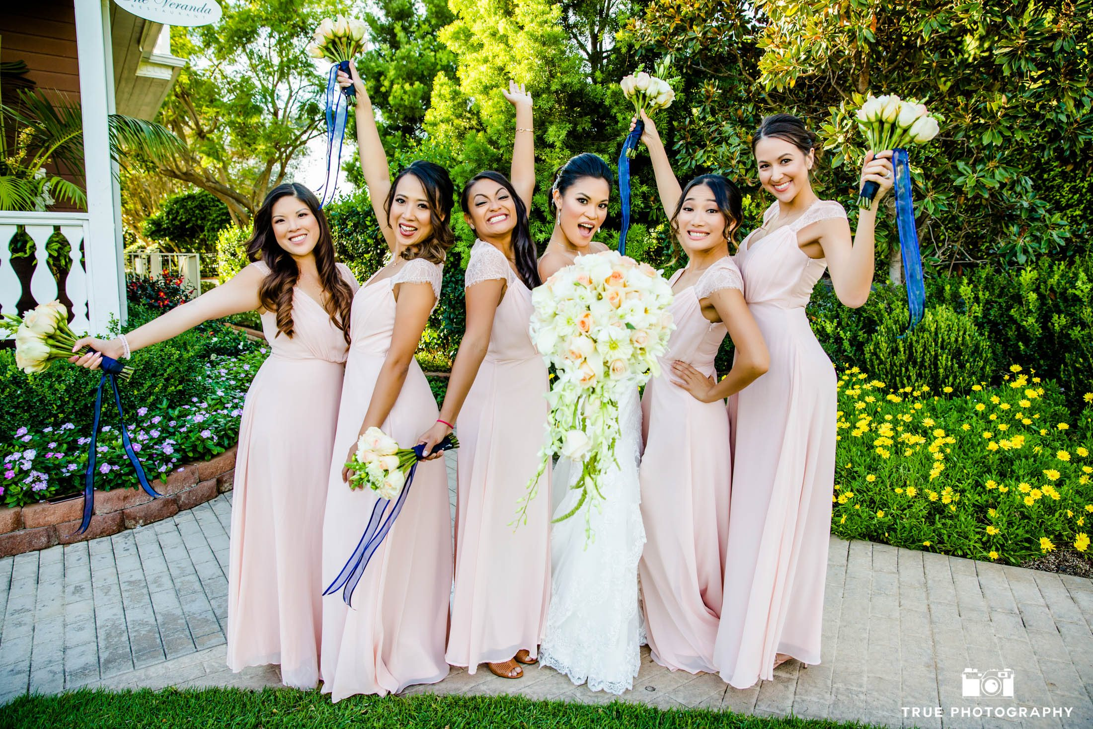 Bride and her bridesmaid celebrate and show their excitement