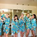 silly bridesmaids eating spaghetti before the wedding starts