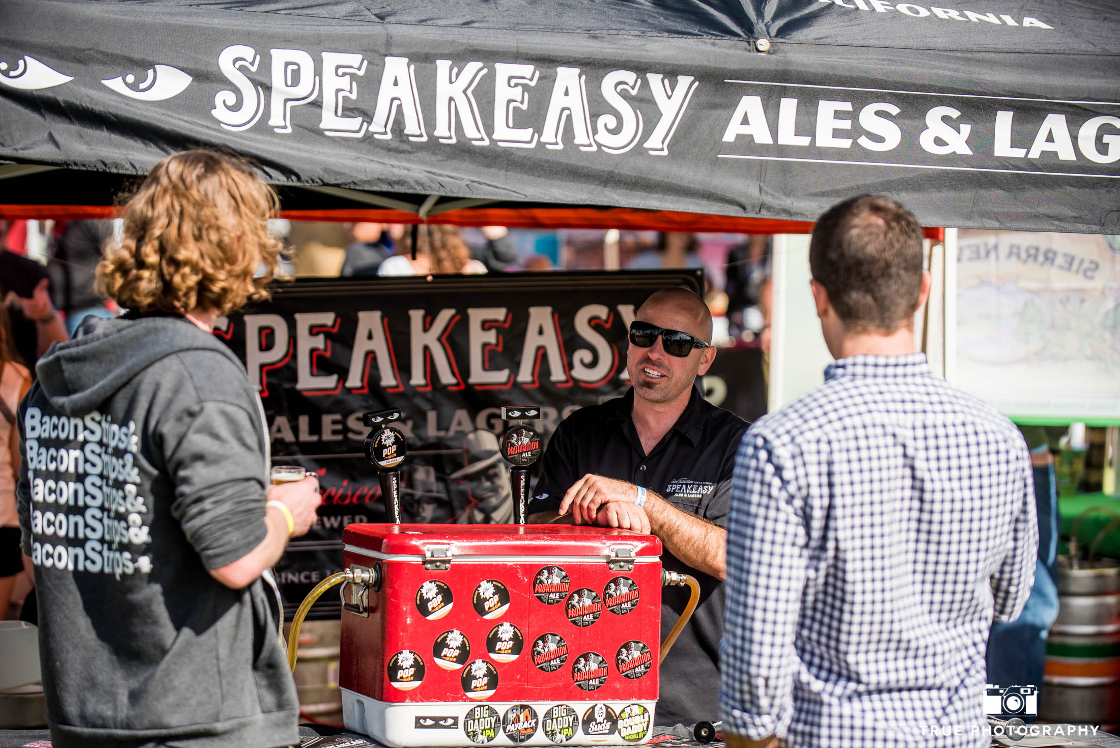 Speakeasy Ales and Lagers talk to eventgoers during cancer charity event, Best Coast Beer Fest