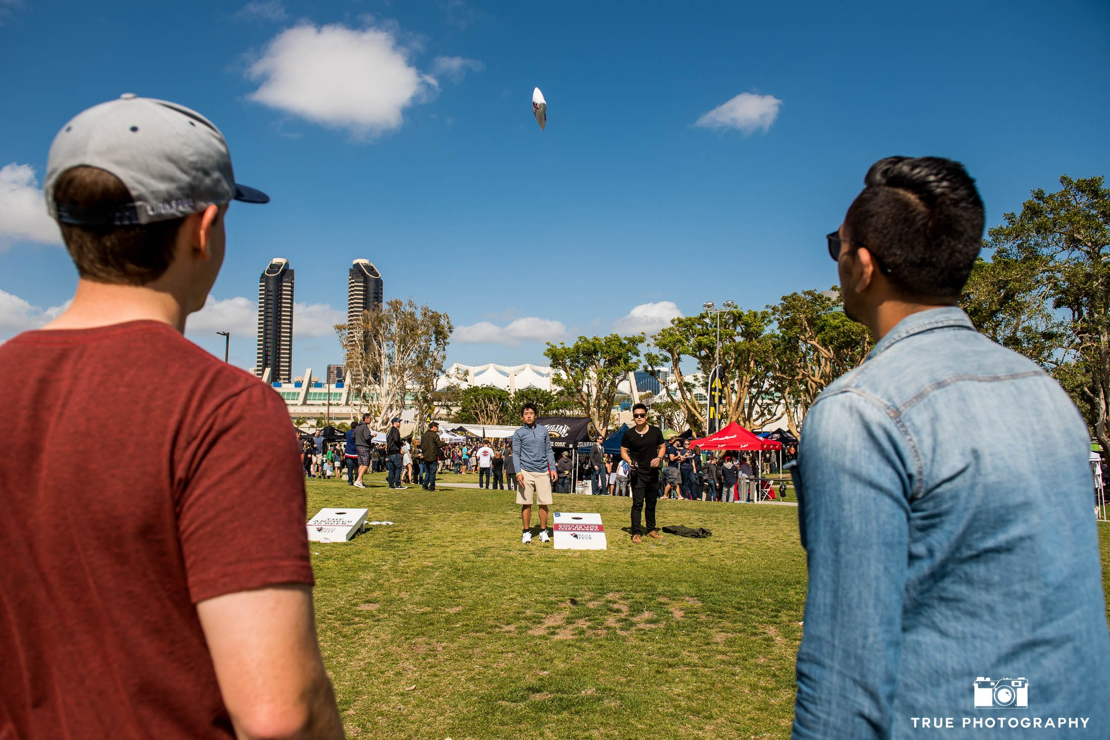 Friends play lawn games during cancer charity event, Best Coast Beer Fest