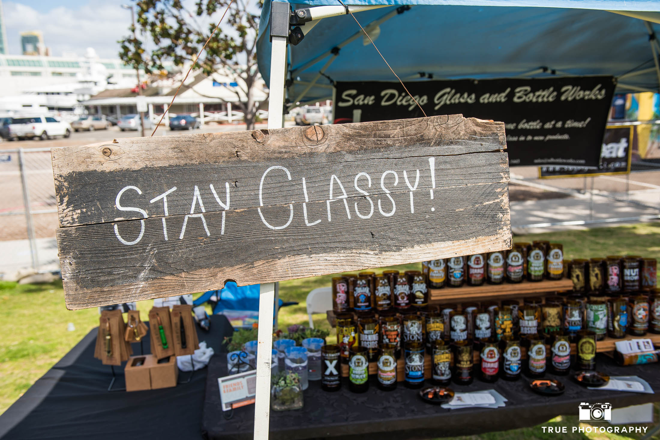 Stay Classy wooden sign outside booth at Best Coast Beer Fest