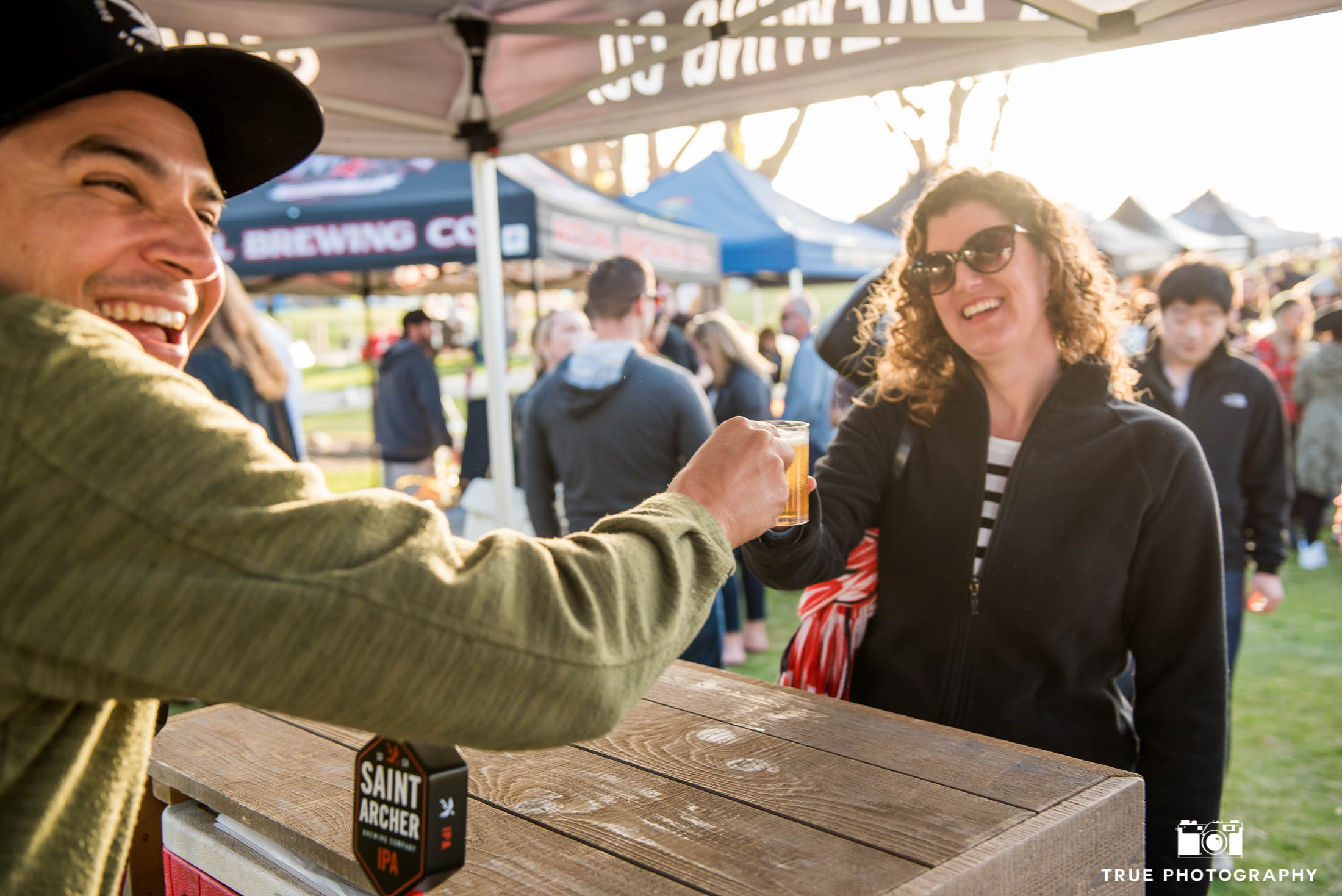 St. Archer Brewing Company brewer interacts with event goers at craft beer booth