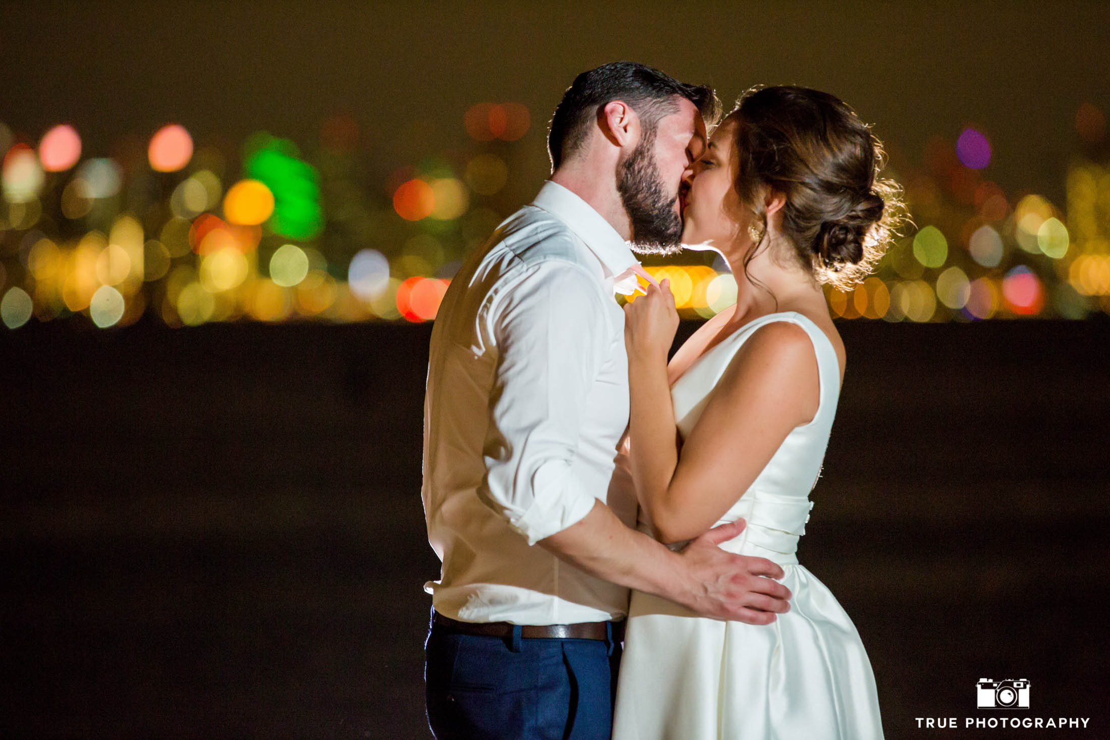 Night wedding photo in front of San Diego skyline