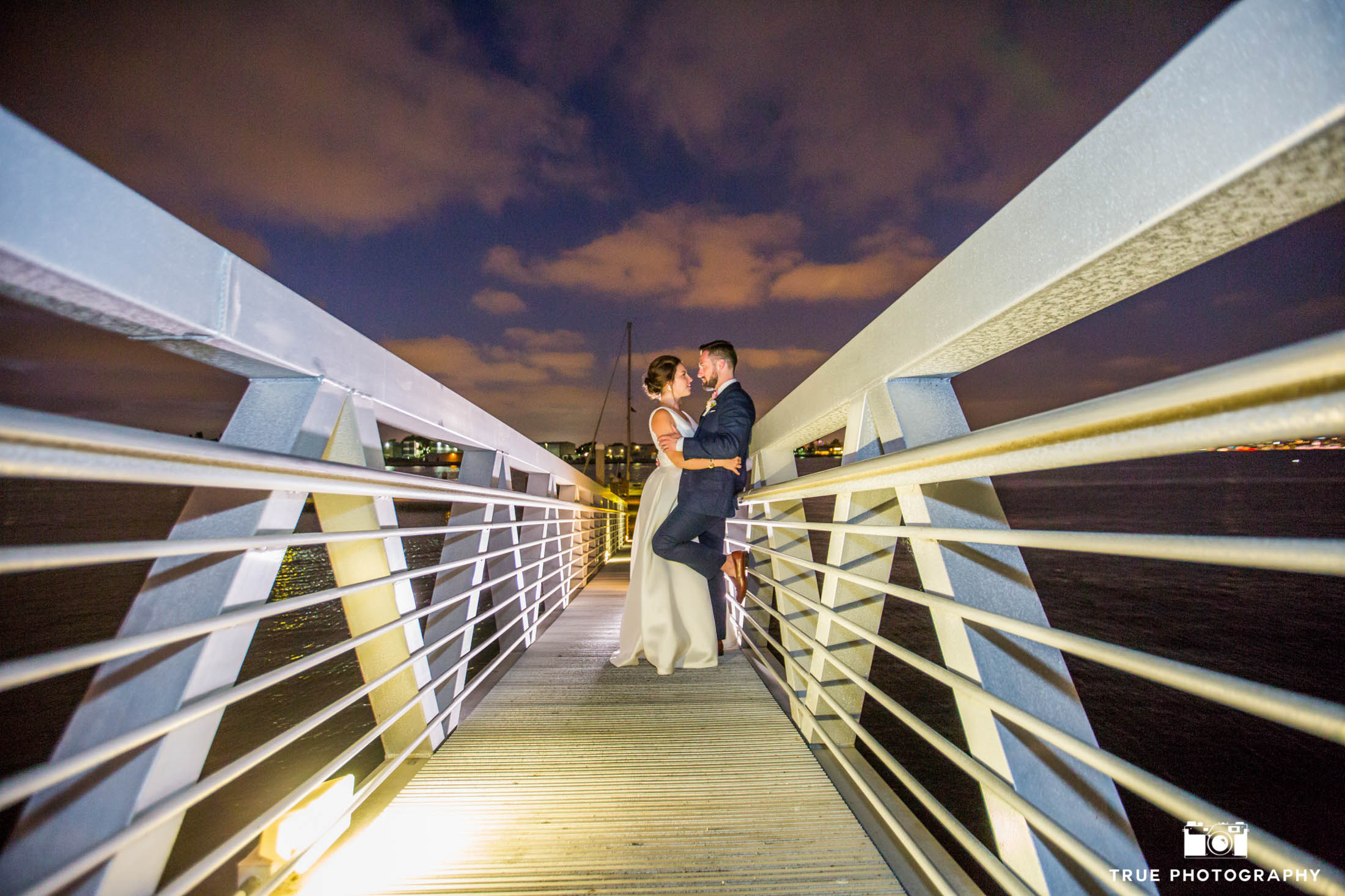 Night photography of bride and groom on a pier