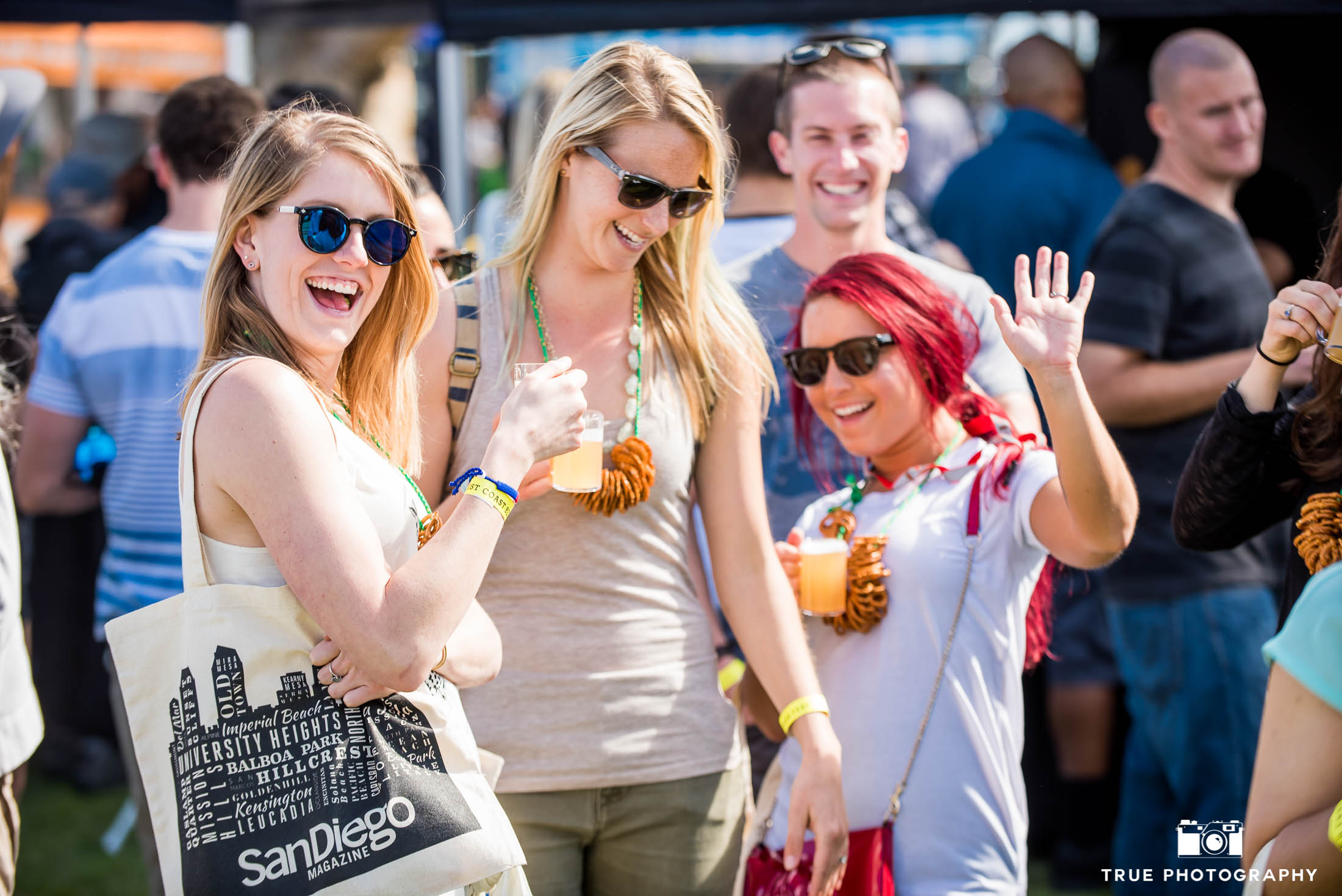 Group of girls smile and pose for group photo during Best Coast Beer Fest