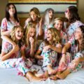 Candid photo of bridesmaids wearing pjs