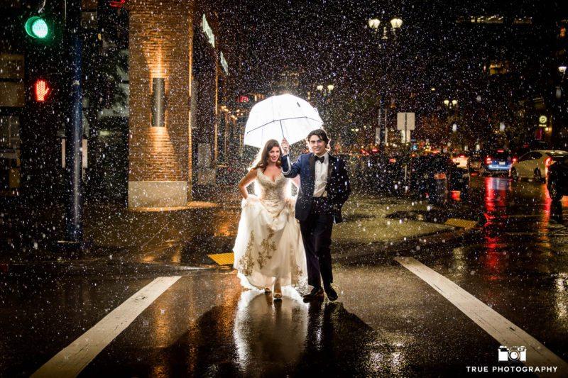 backlit night photo of stylish bride and groom in rain