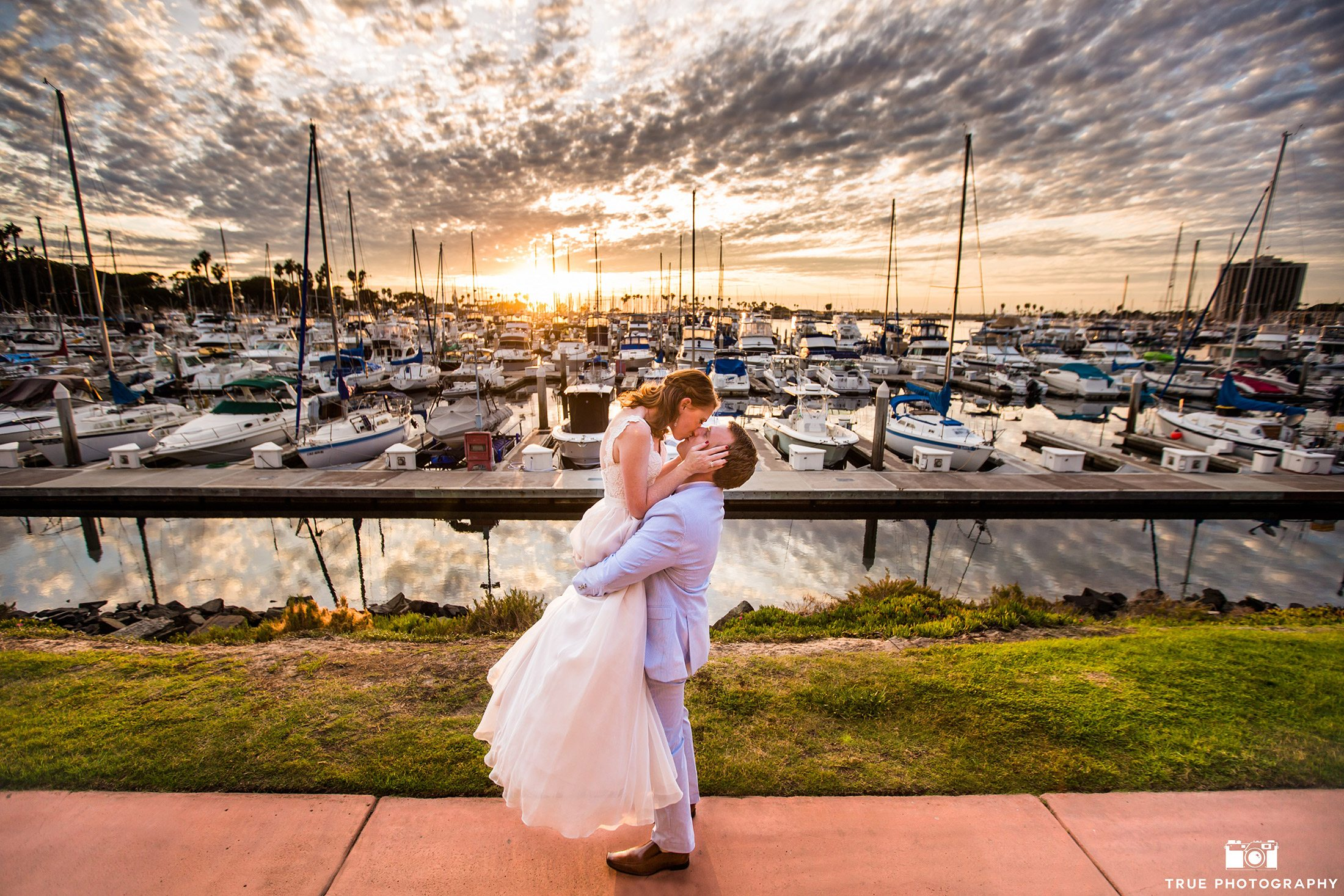 Candid photo of a wedding couple at sunset