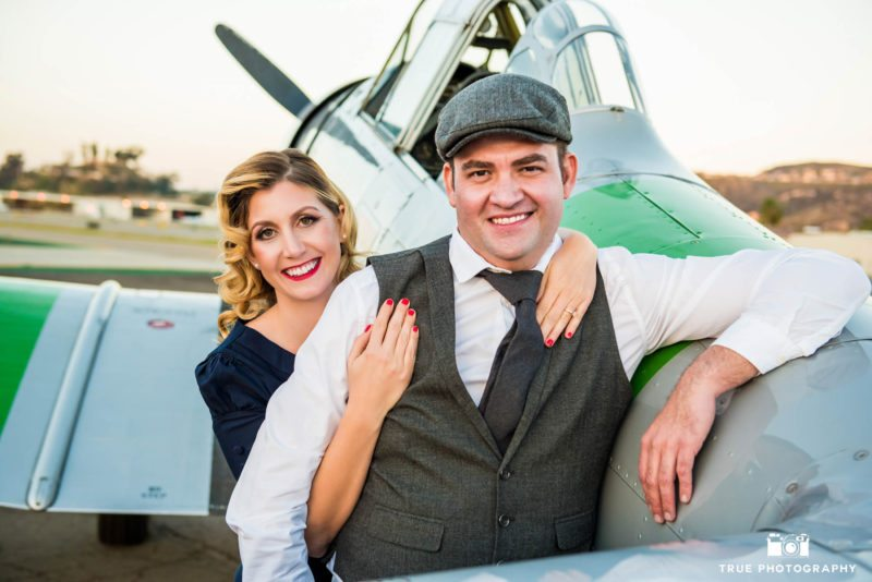 Couple pose for a 1940's inspired engagement shoot
