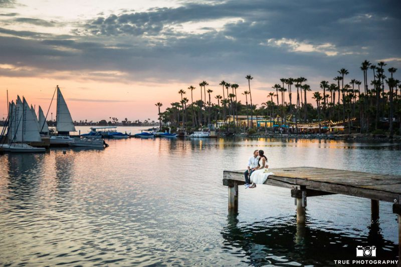 Newlyweds share a quiet moment on the bay.