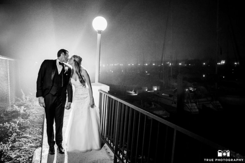 A newly married couple takes a night stroll in heavy fog.