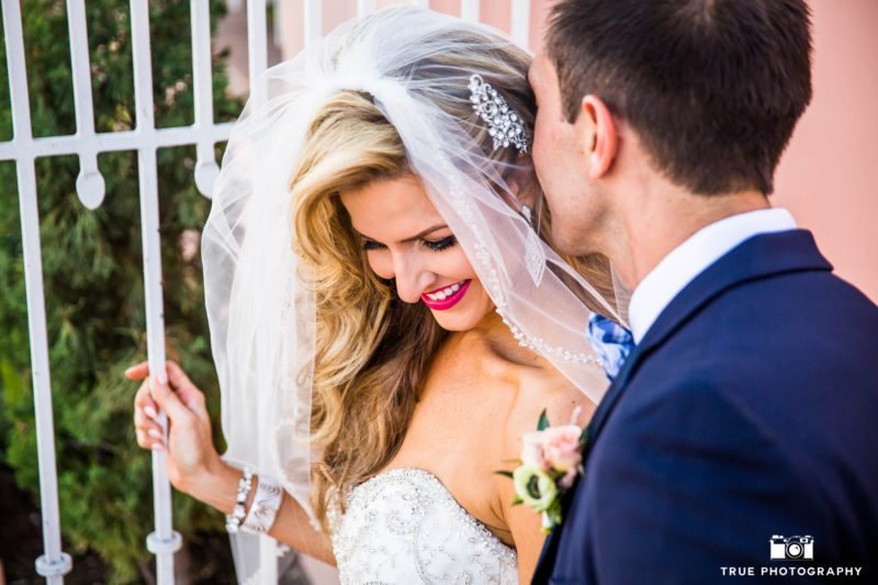 Bride giggles with Groom during candid moment