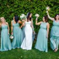 Funny Bridesmaids hold up bouquets