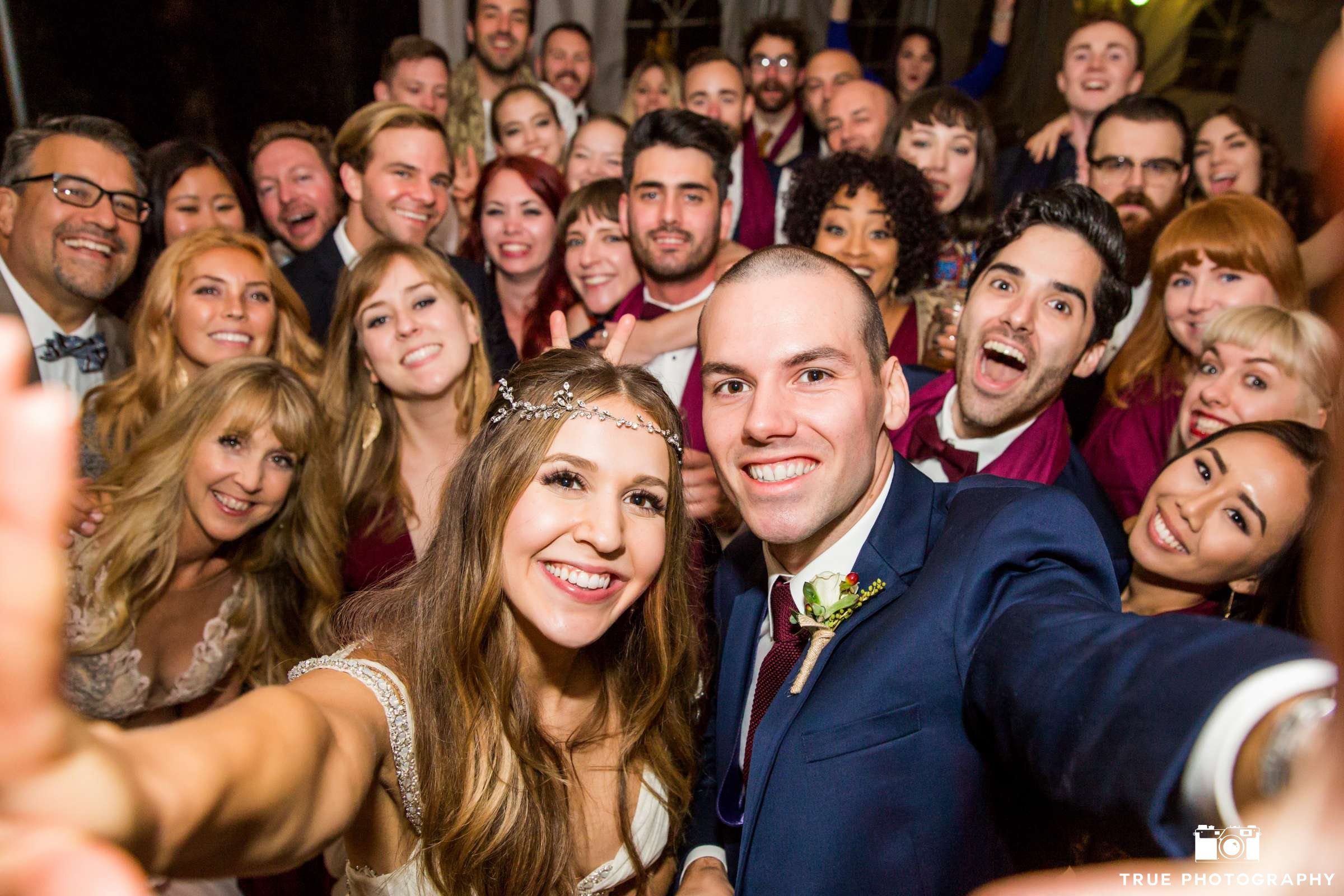 A newly married couple captures the moment with a selfie.