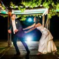 Funny night photo of bride and groom during wedding reception