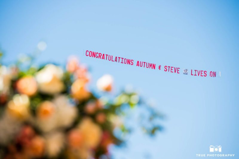 Air banner in sky for wedding couple