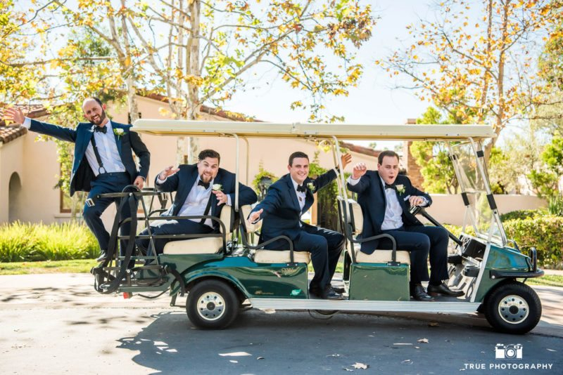 Action shot of grooms on cart