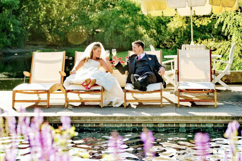 Newlyweds toast by the pool