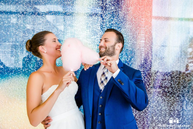 Candid portrait of bride and groom with cotton candy