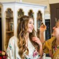 Bride laughing with bridesmaid during getting ready photos