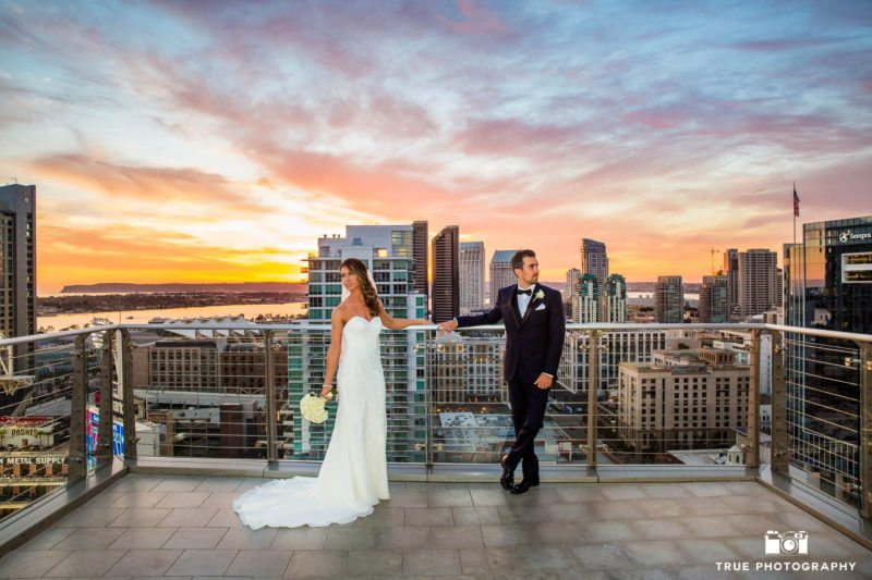 Bride and Groom on rooftop during sunset at the ultimate skybox